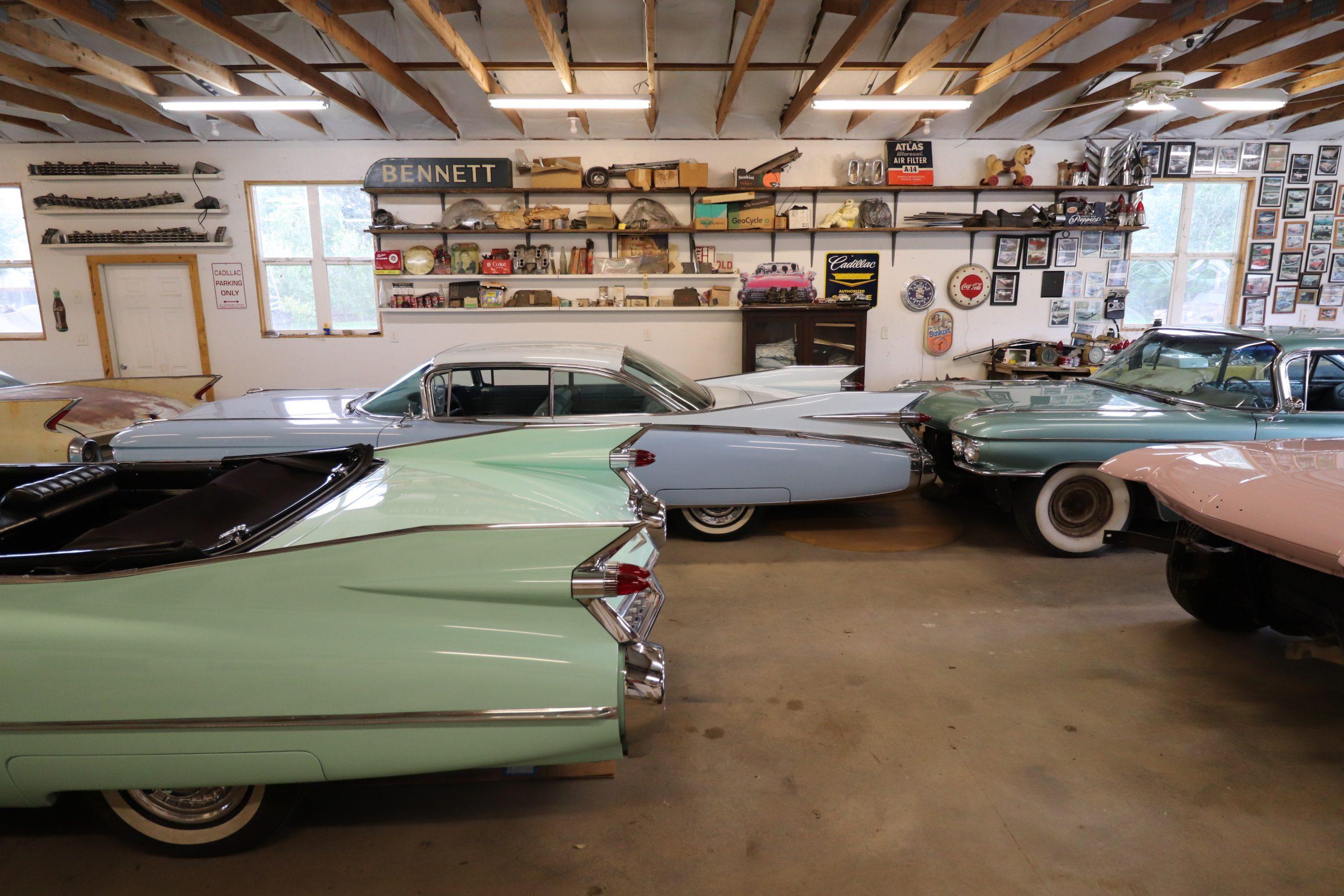 old vintage cadillacs in garage side profile