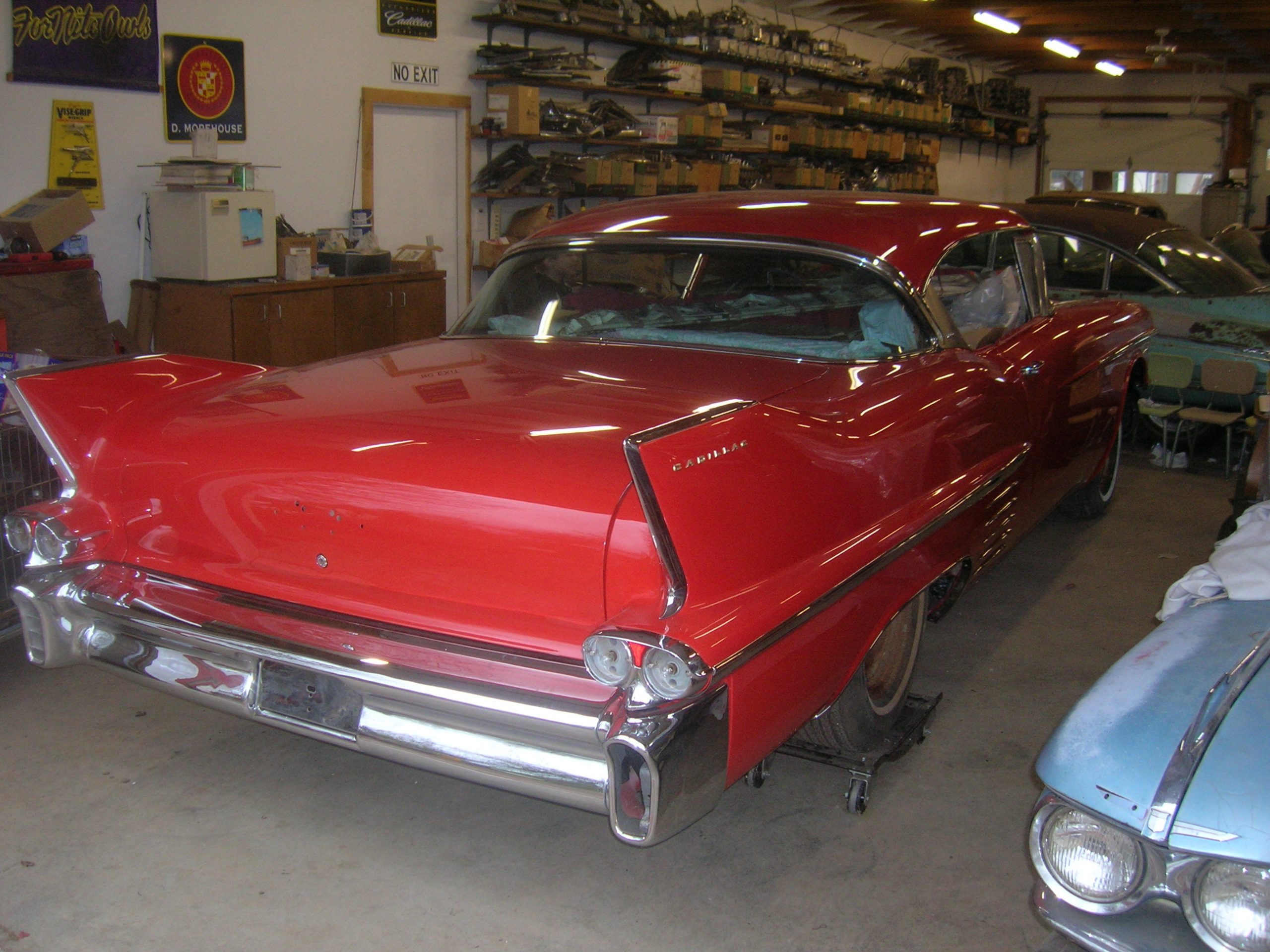 red old vintage cadillac fins rear three-quarter