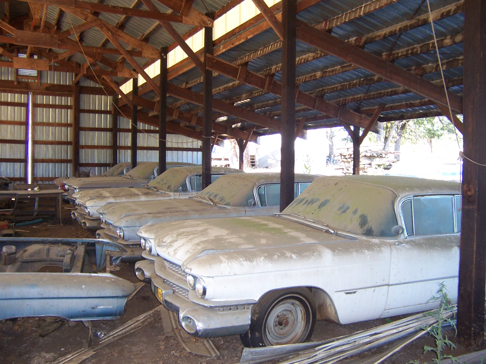 old vintage cadillac in barn
