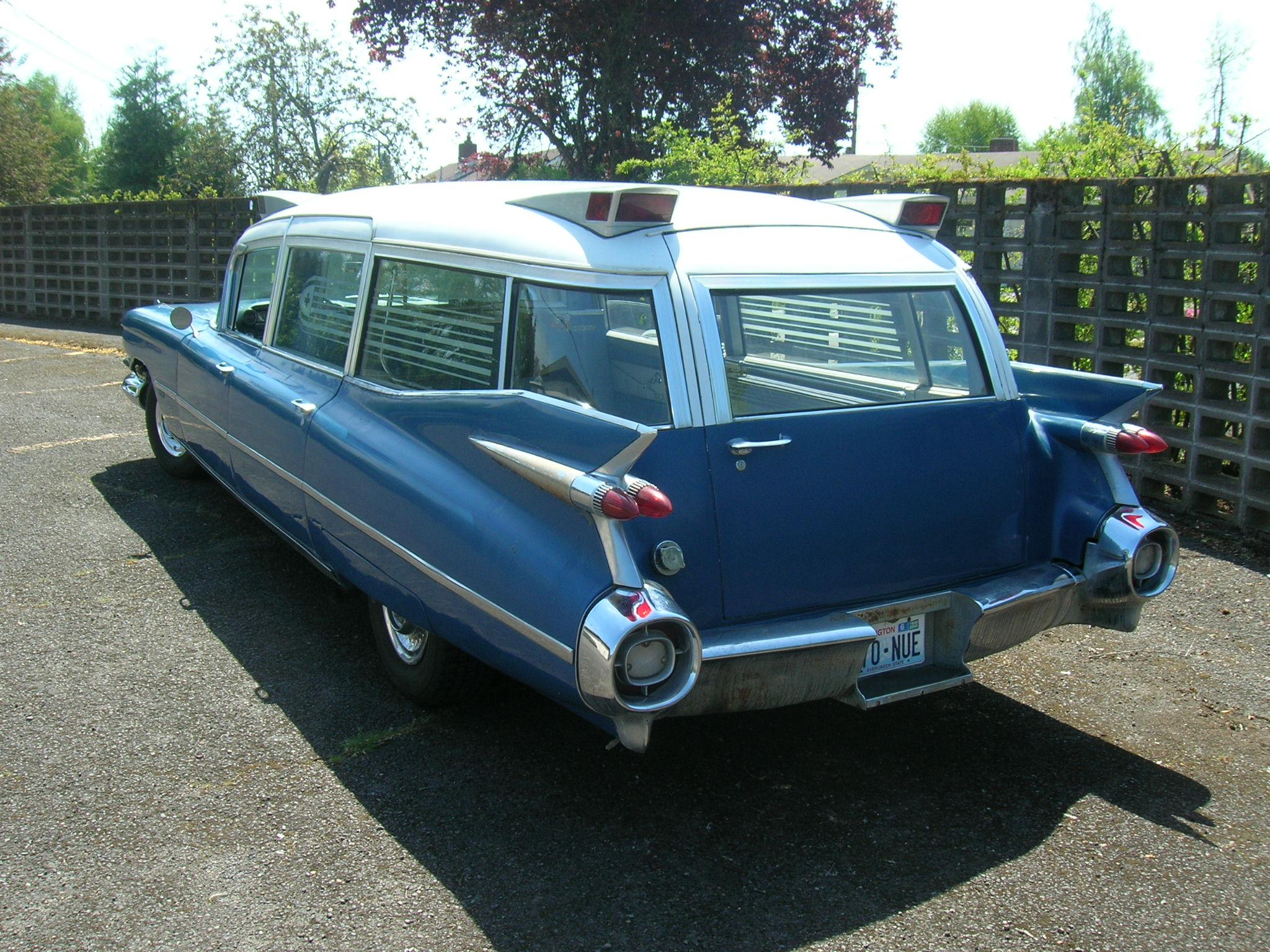 old vintage cadillac wagon rear three-quarter