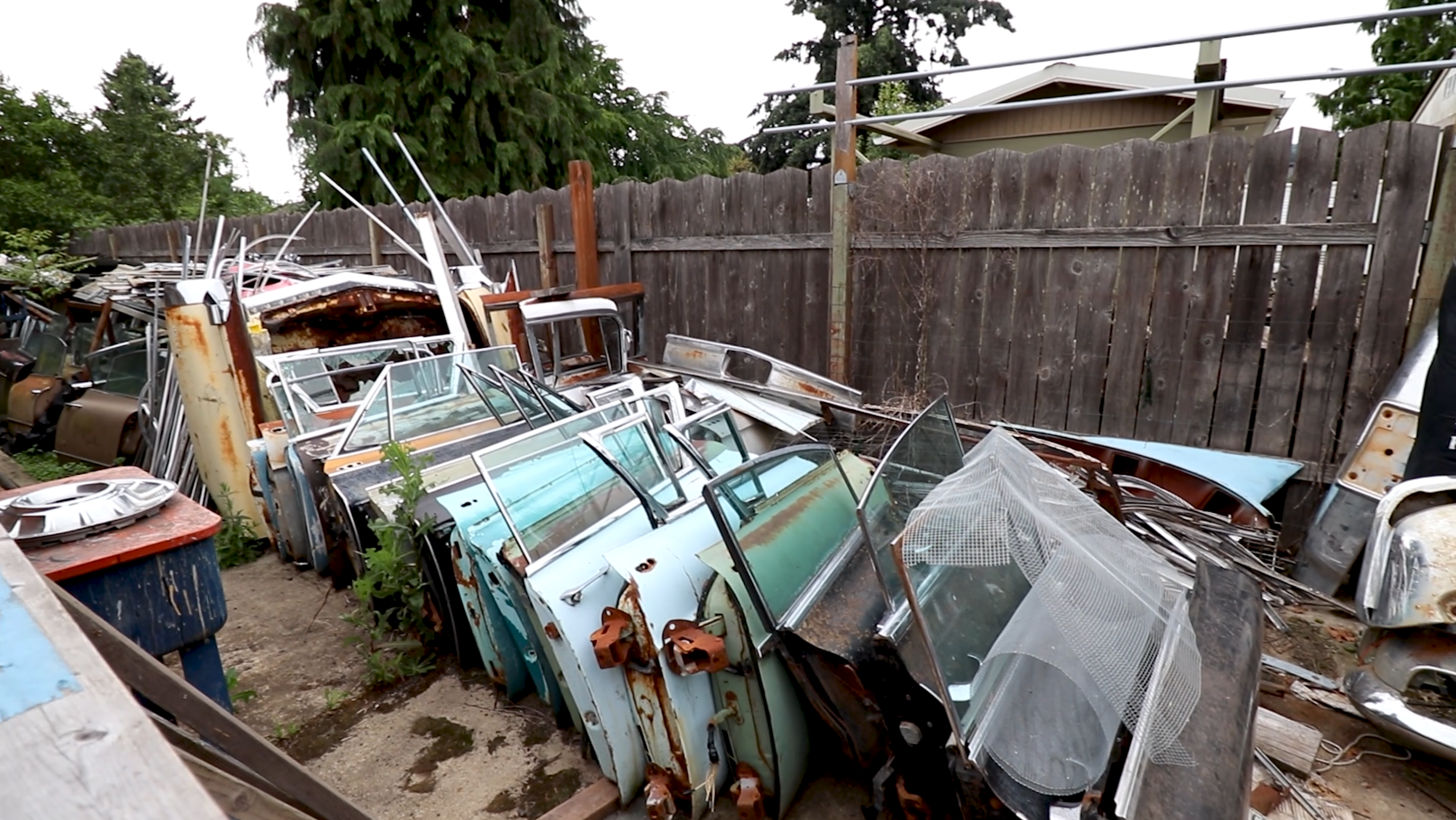 old vintage cadillac doors stacked