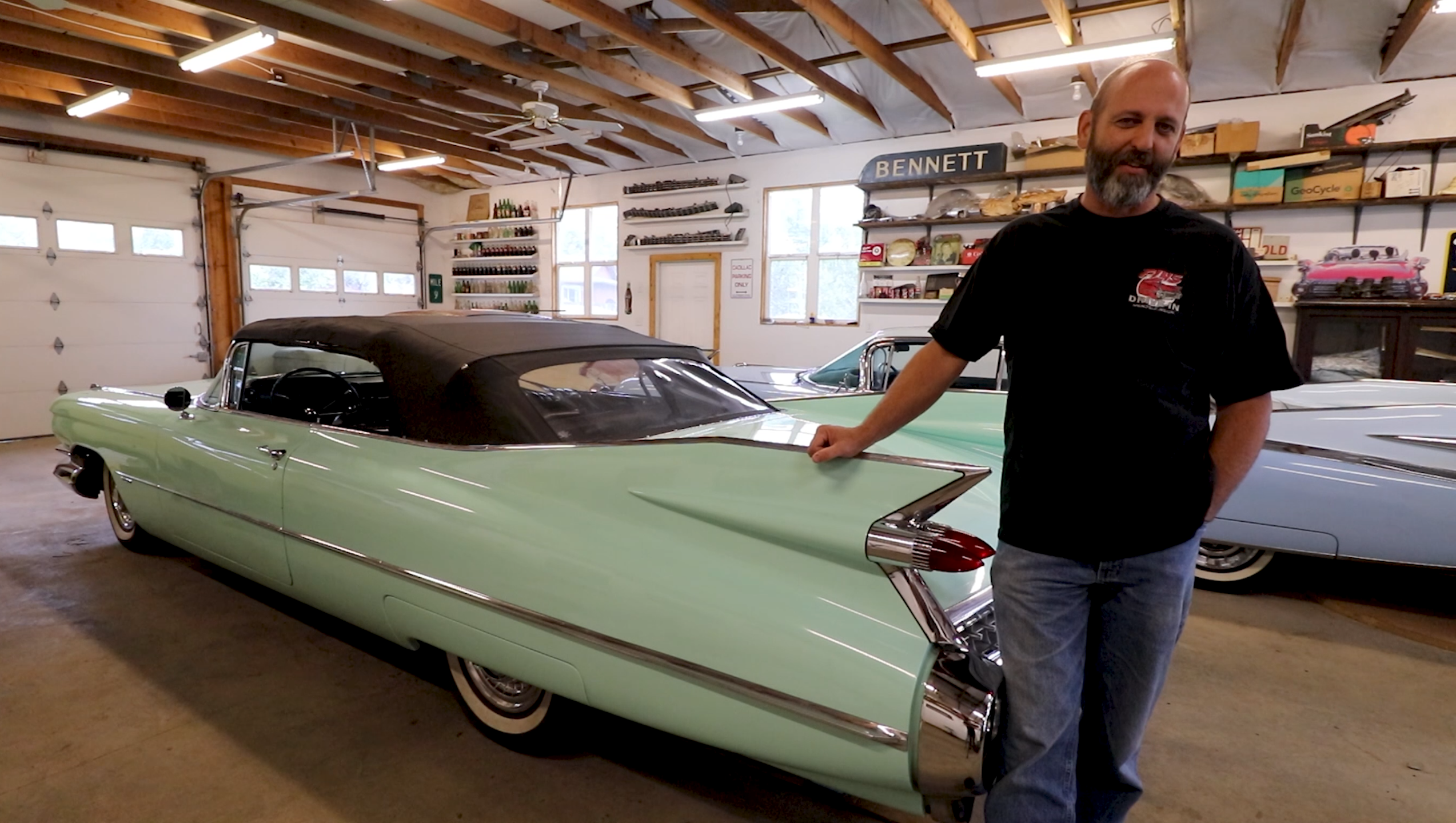 Dan Morehouse with old vintage cadillac in garage