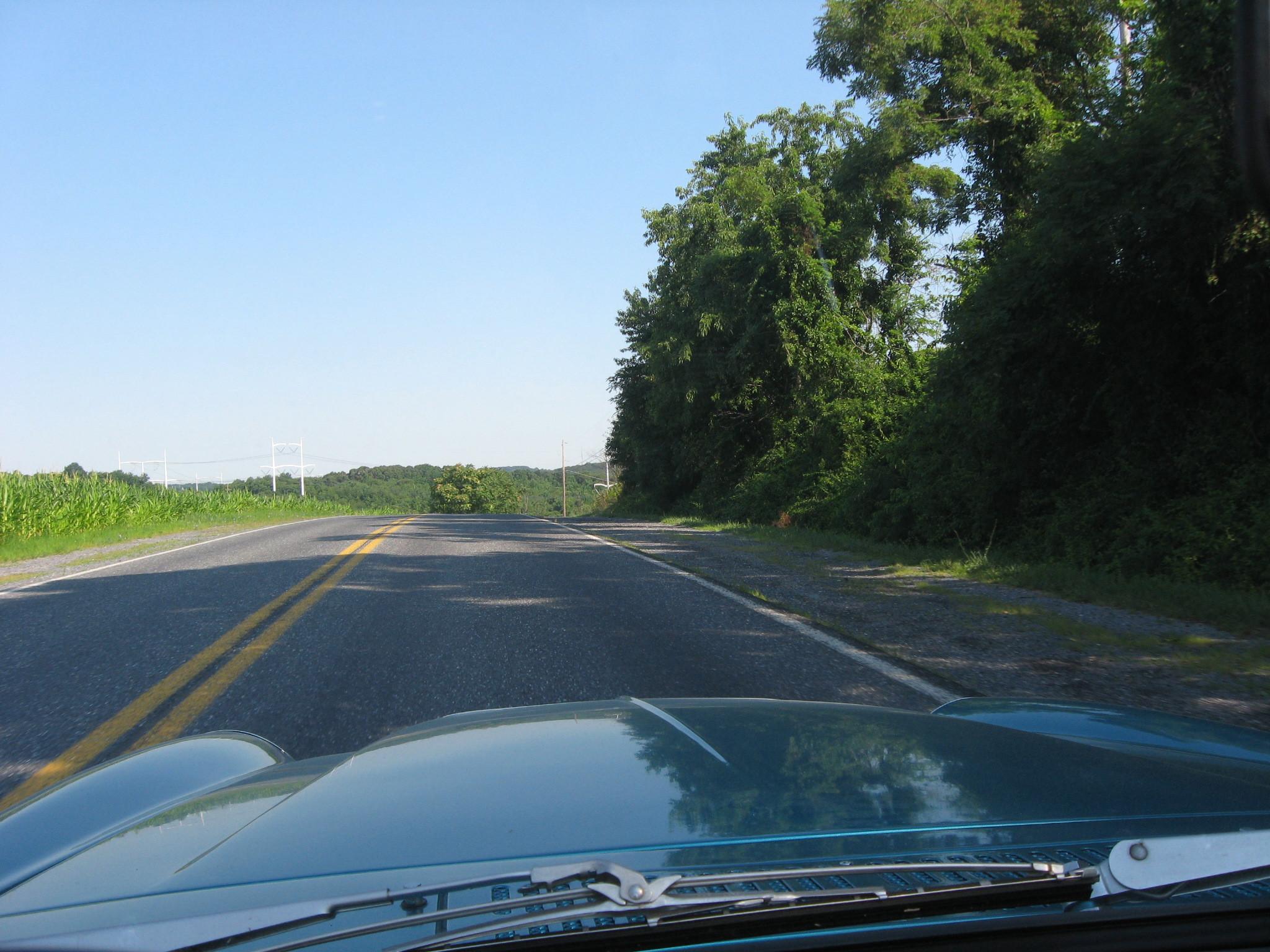 1968 Datsun 1600 roadster driving open road