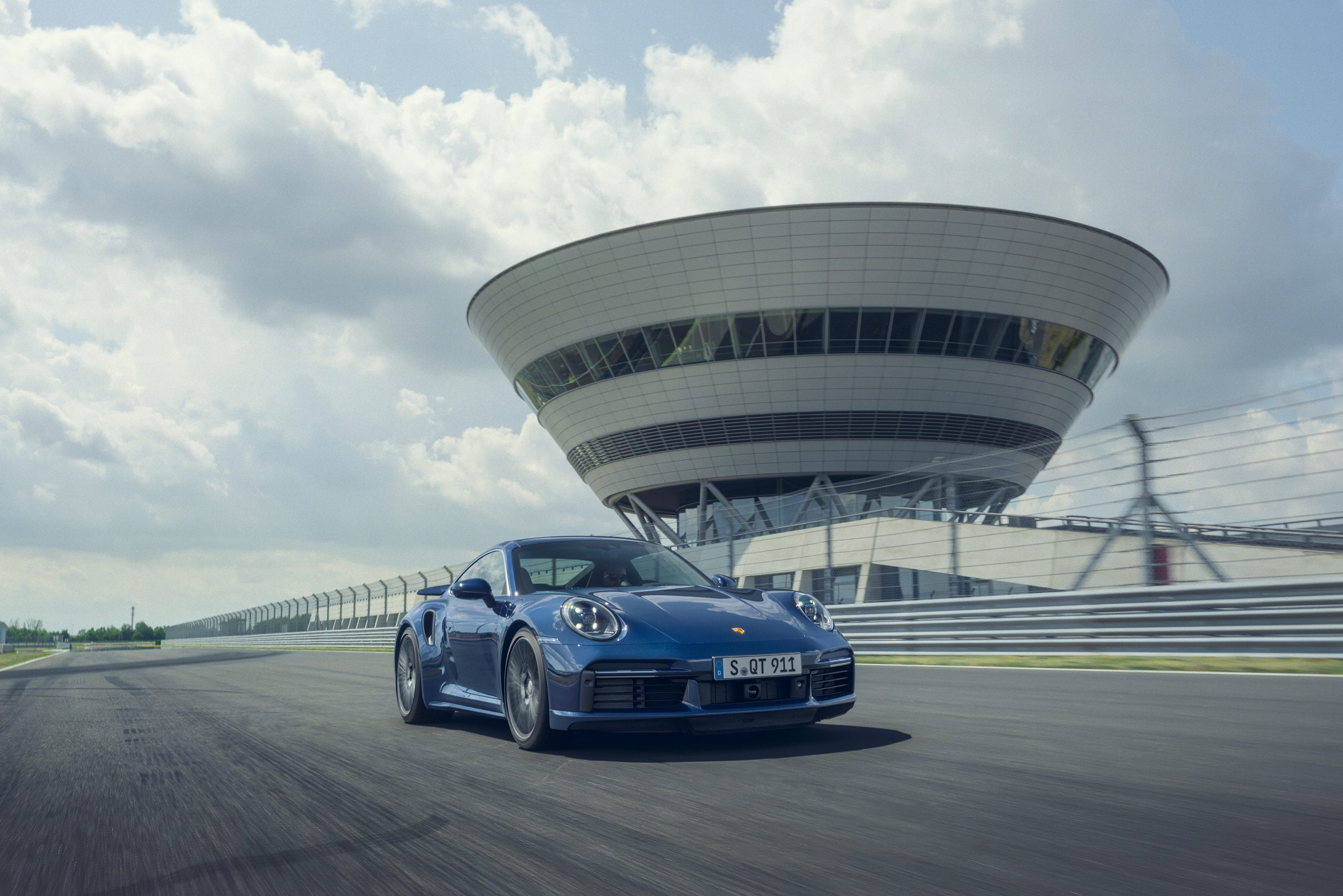 2021 Porsche 911 Turbo on track action front three-quarter