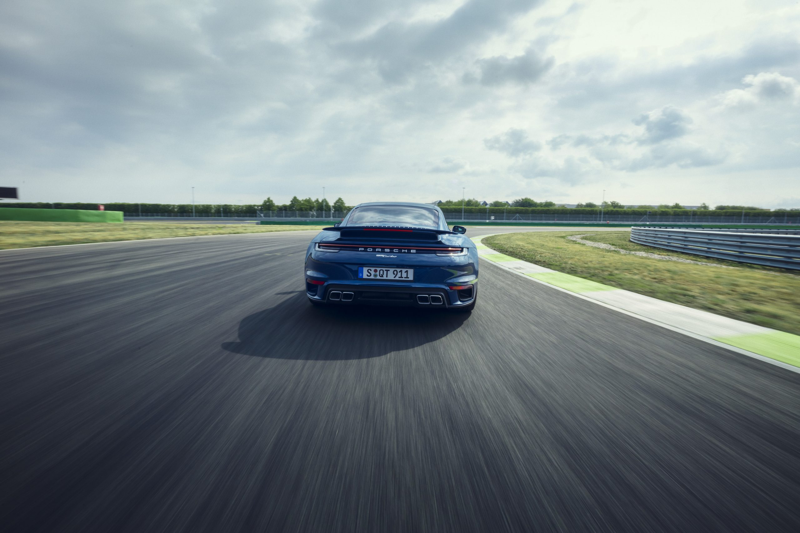 2021 Porsche 911 Turbo on track action rear