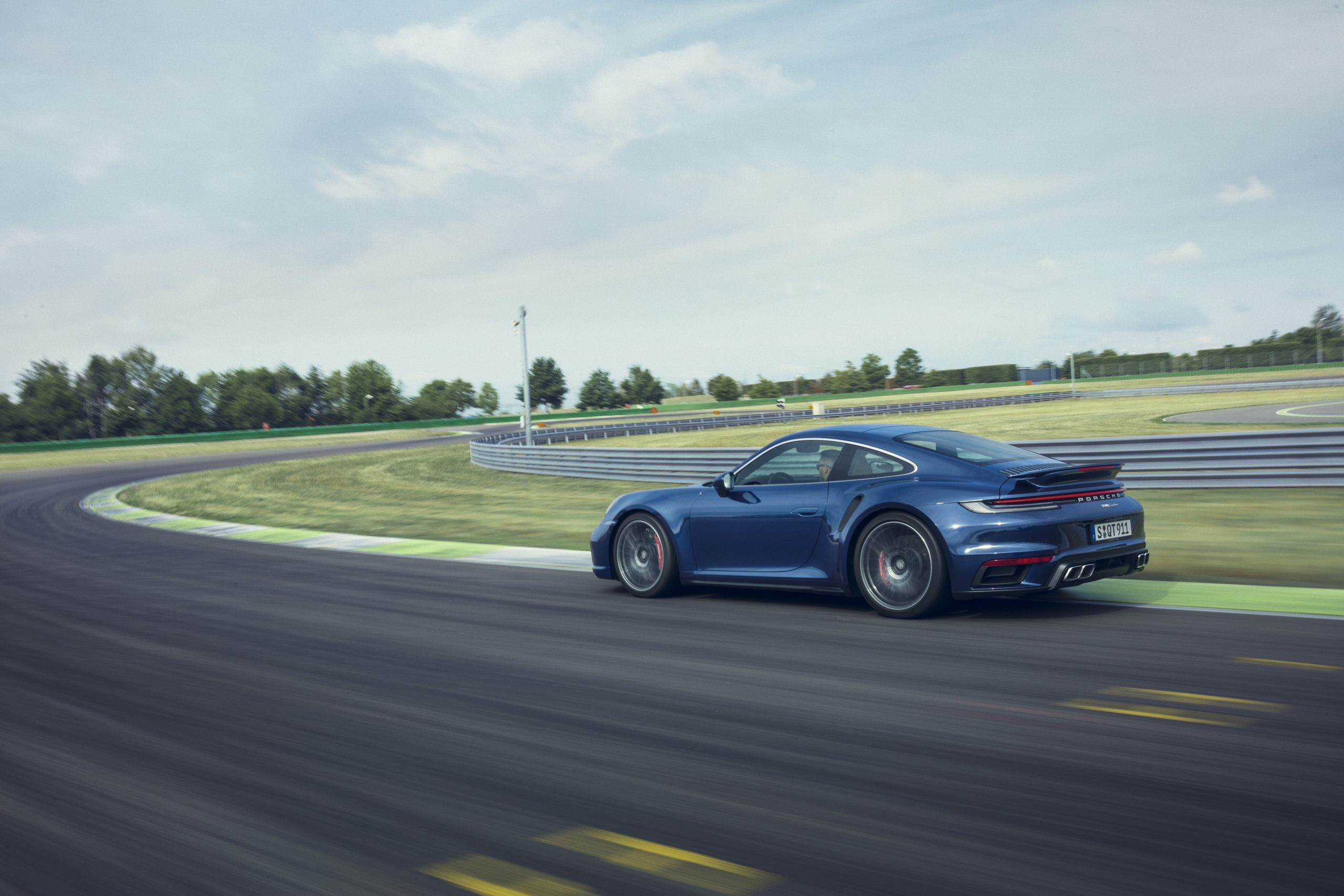 2021 Porsche 911 Turbo on track action rear three-quarter