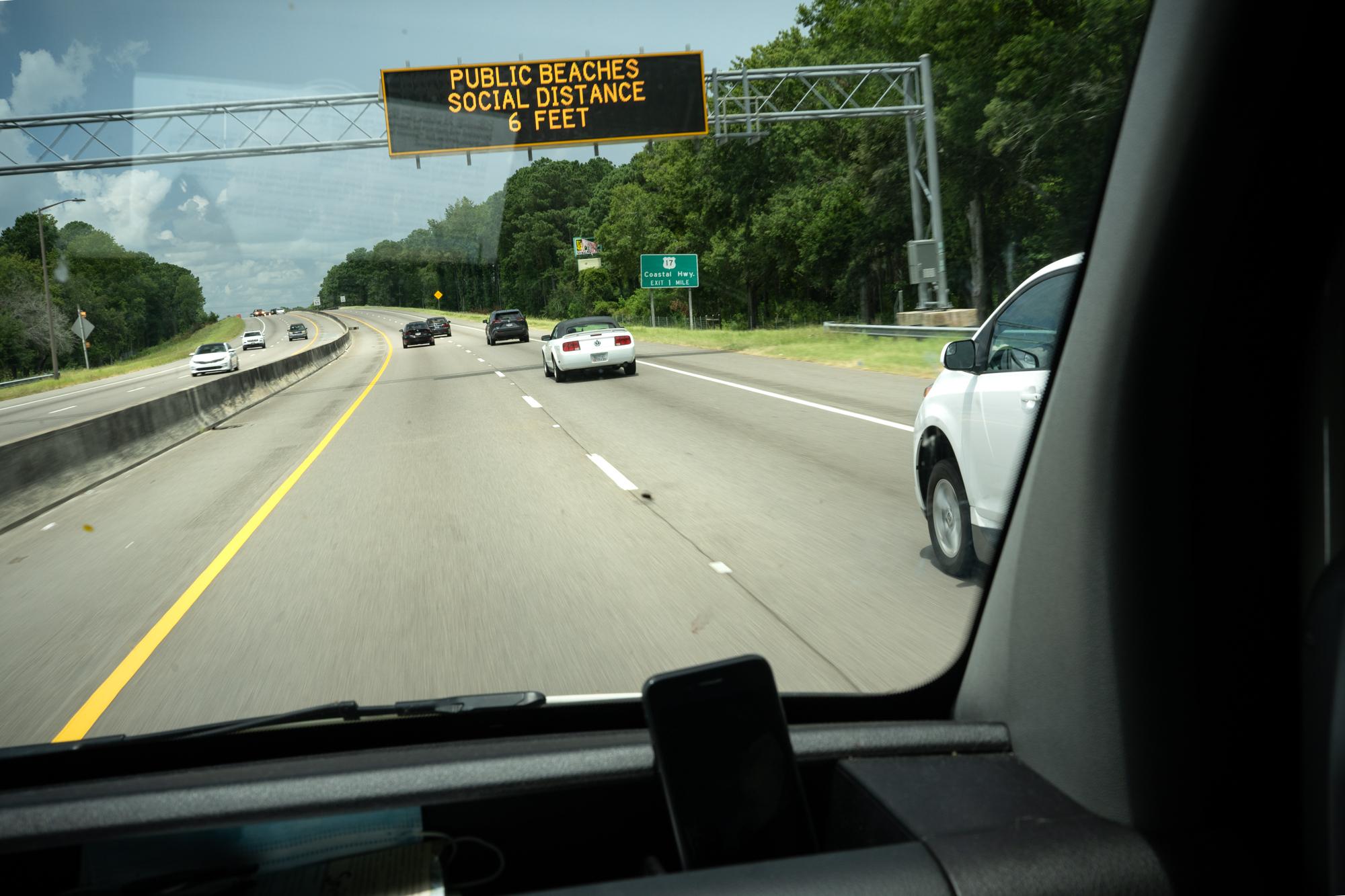 social distance public service announcement sign