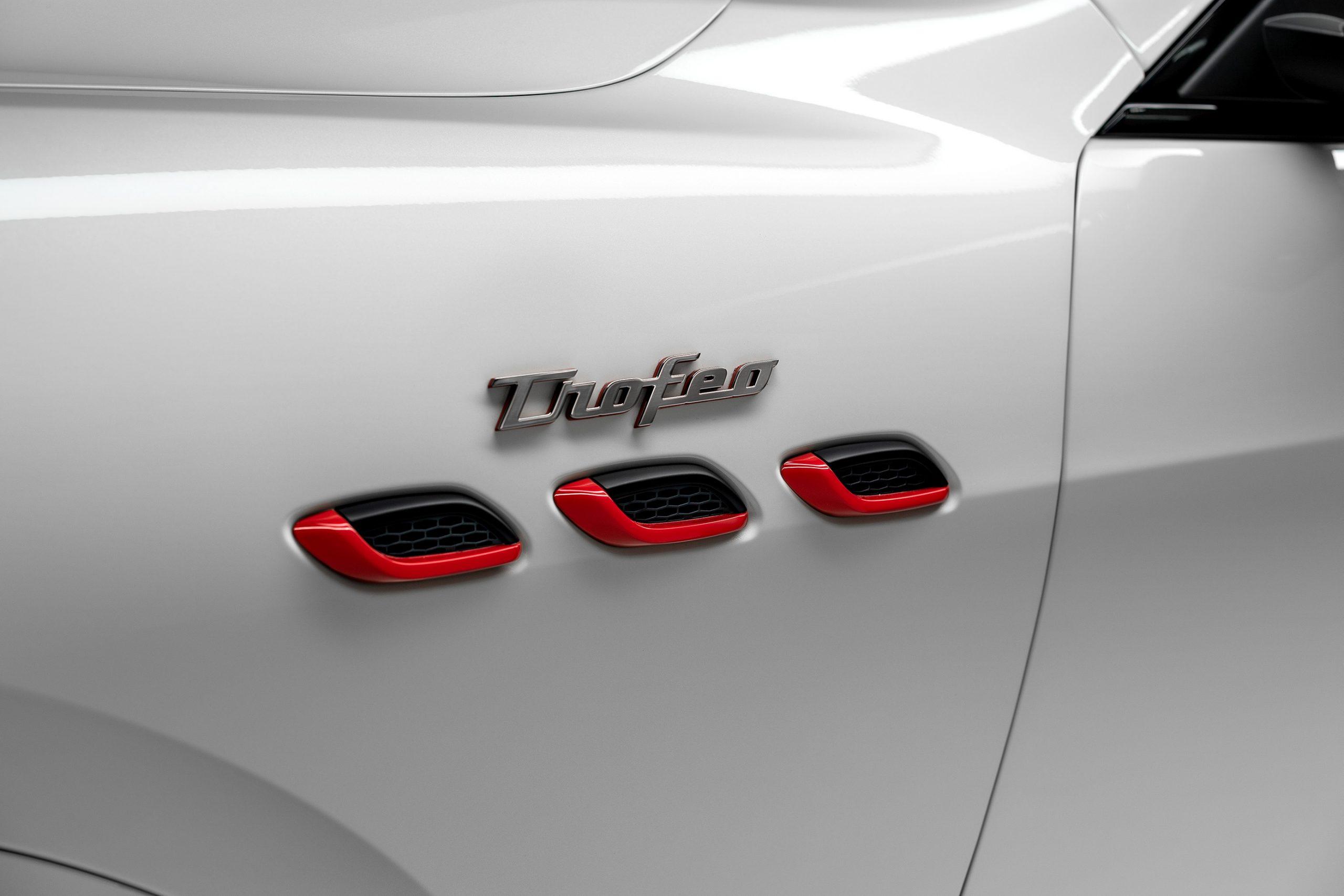 white trofeo levante badging details