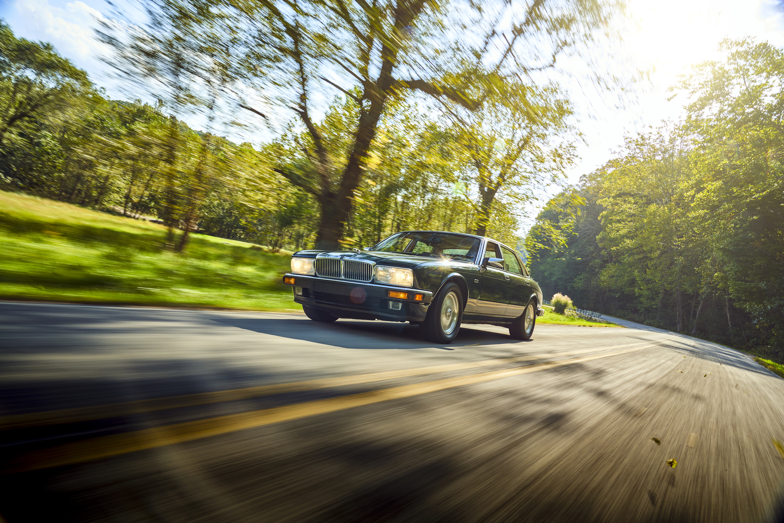 Jaguar XJ6 front three-quarter dynamic road action