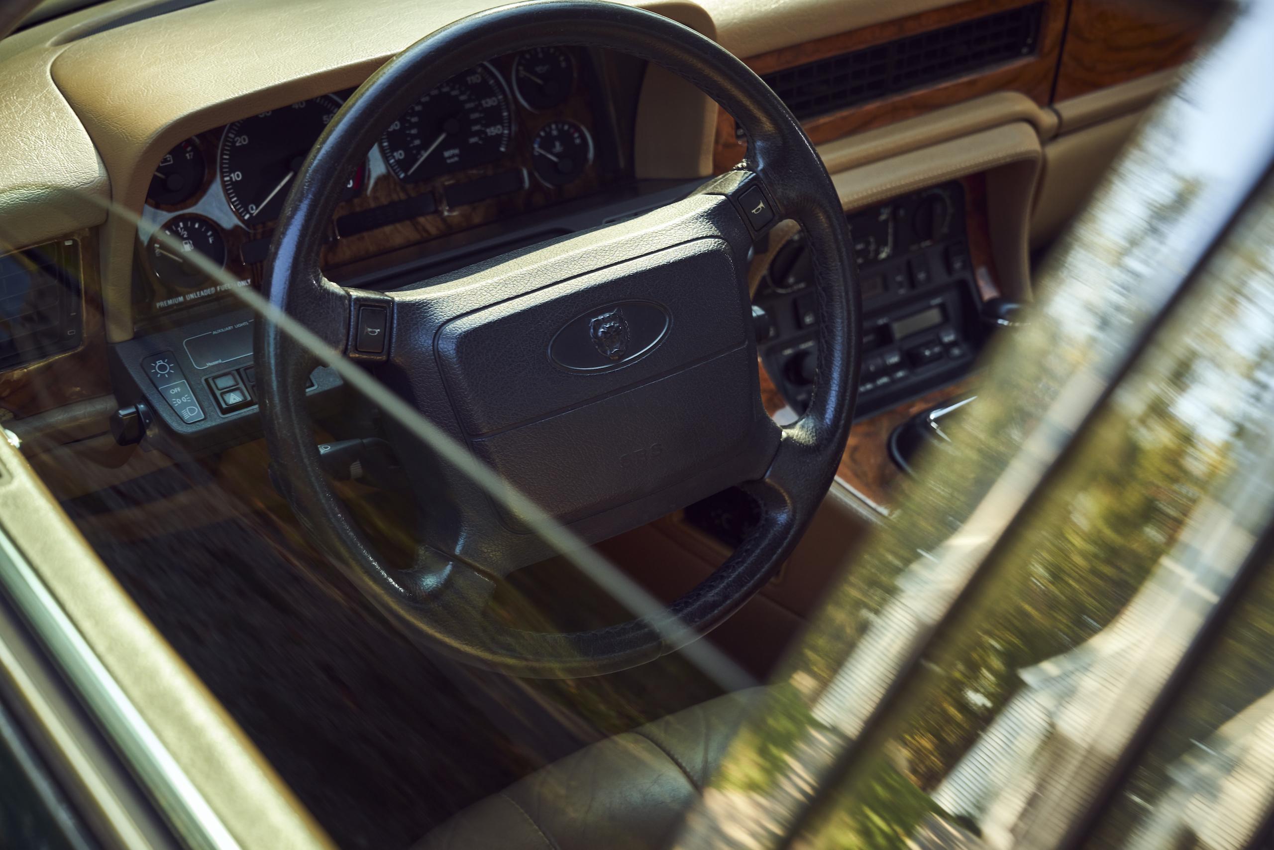 Jaguar XJ6 steering wheel through lowered window