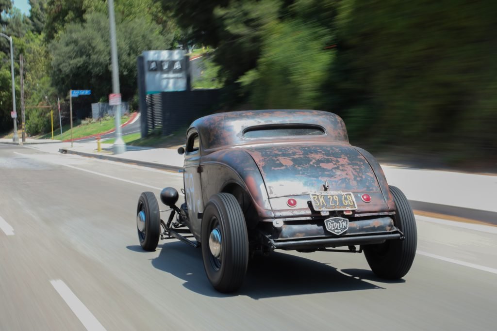 1934 Ford coupe driving rear