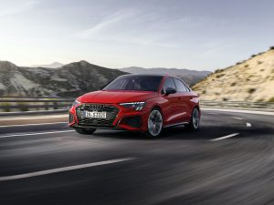Audi S3 Sedan tango red front three-quarter