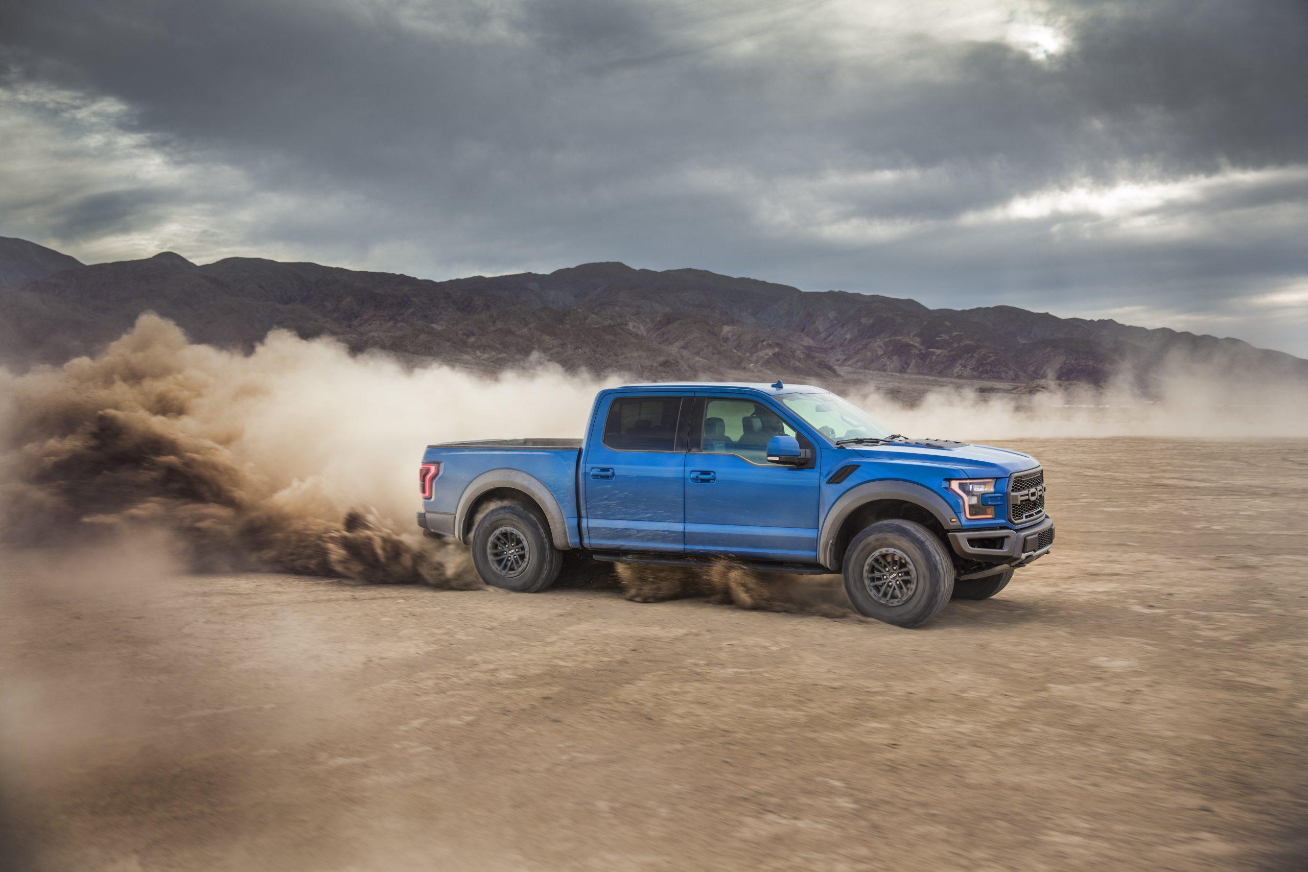 2019 Ford Raptor side profile slinging dirt