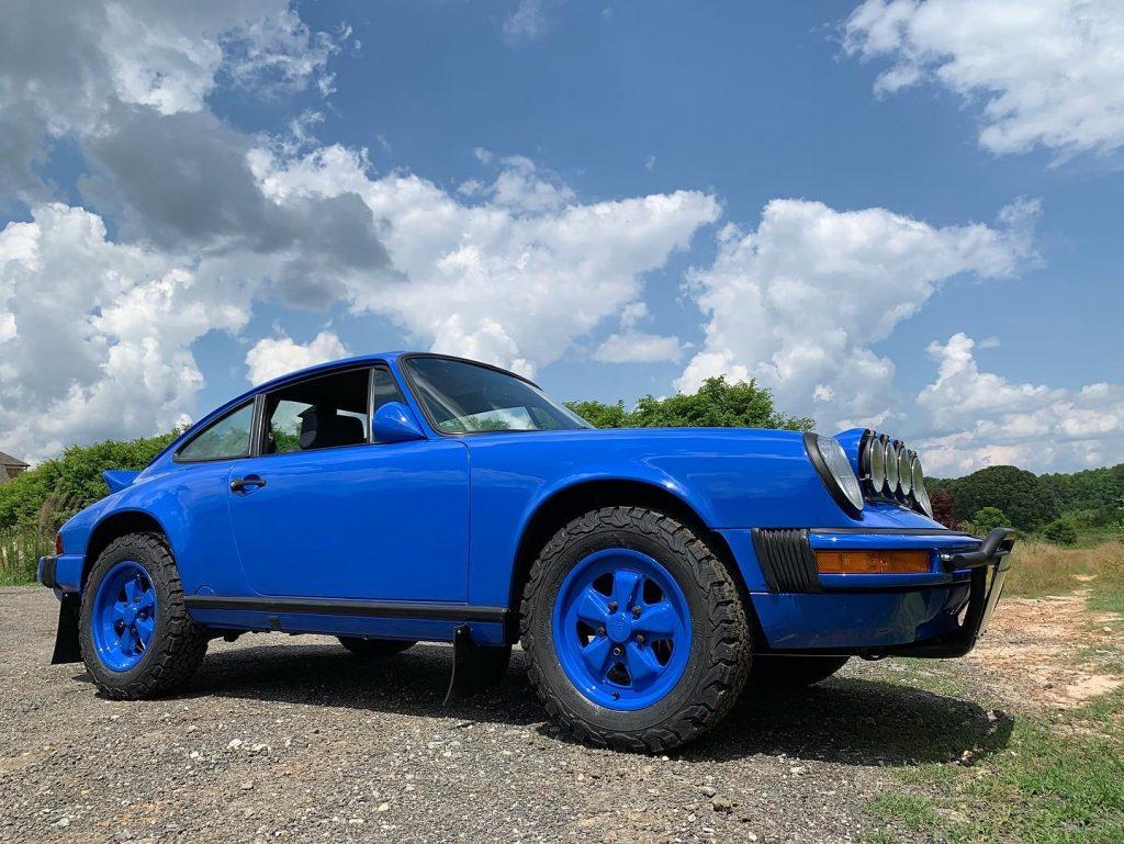 porsche 911 blue safari car front three-quarter