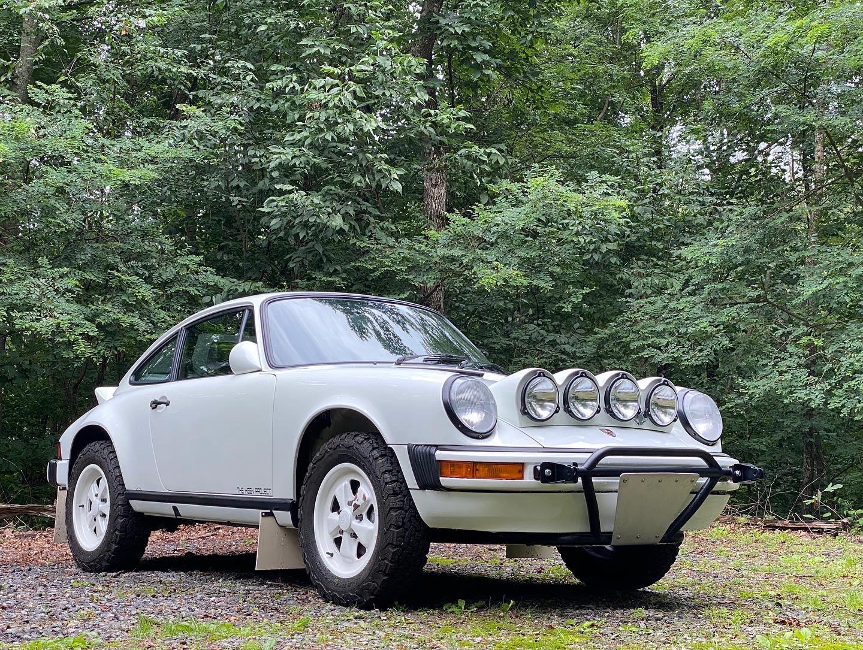 porsche 911 safari car white front three-quarter
