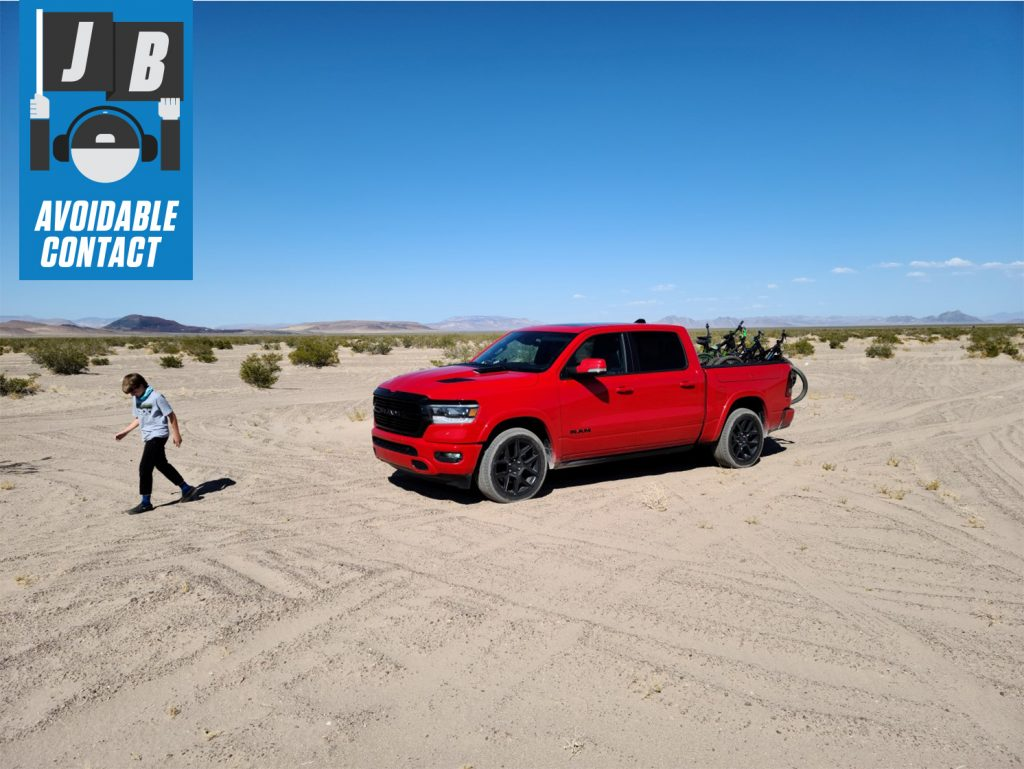 Avoidable Contact Red Ram TLX with bikes and boy in desert