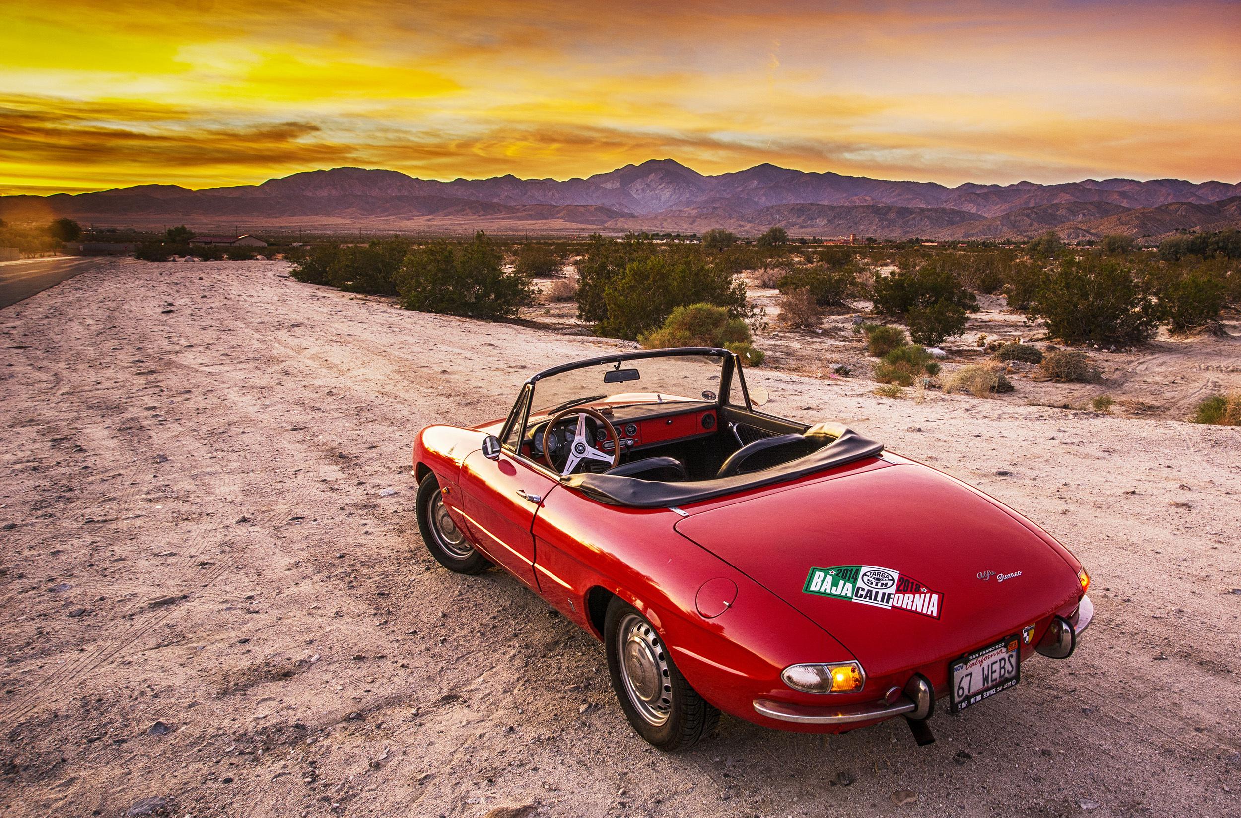 vintage 1967 alfa romeo duetto rear three-quarter sunset