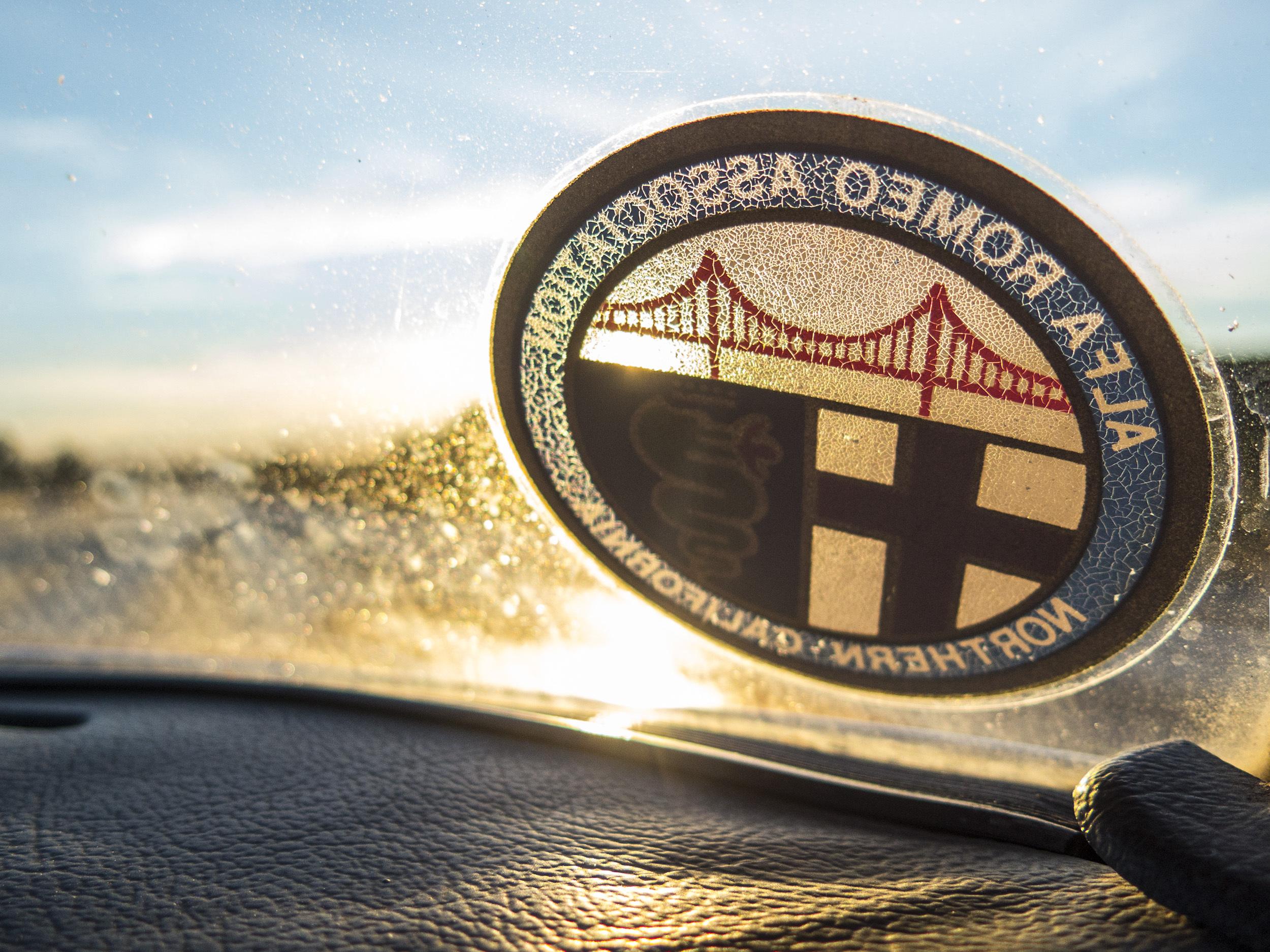 vintage alfa romeo association aged sticker on windshield