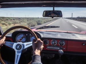 leslie yuen driving his vintage 1967 alfa romeo duetto on interstate