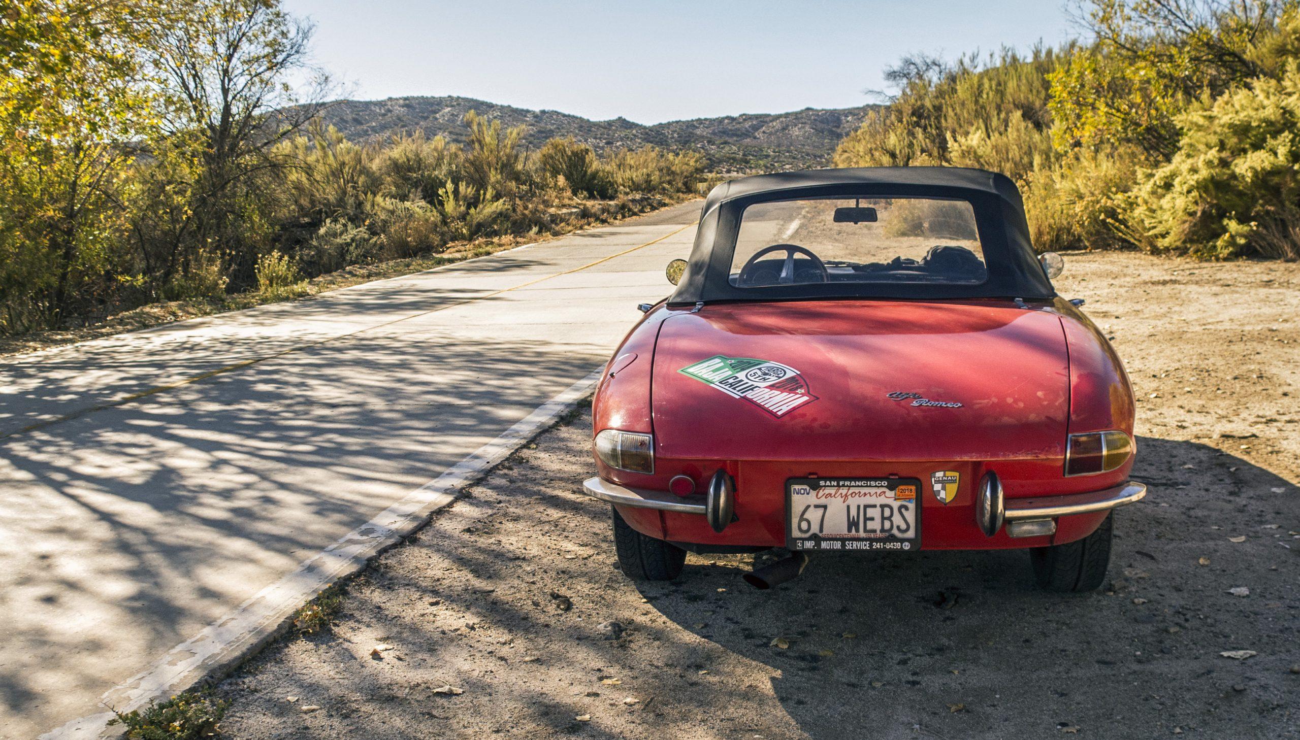 vintage 1967 alfa romeo duetto on roadside rear