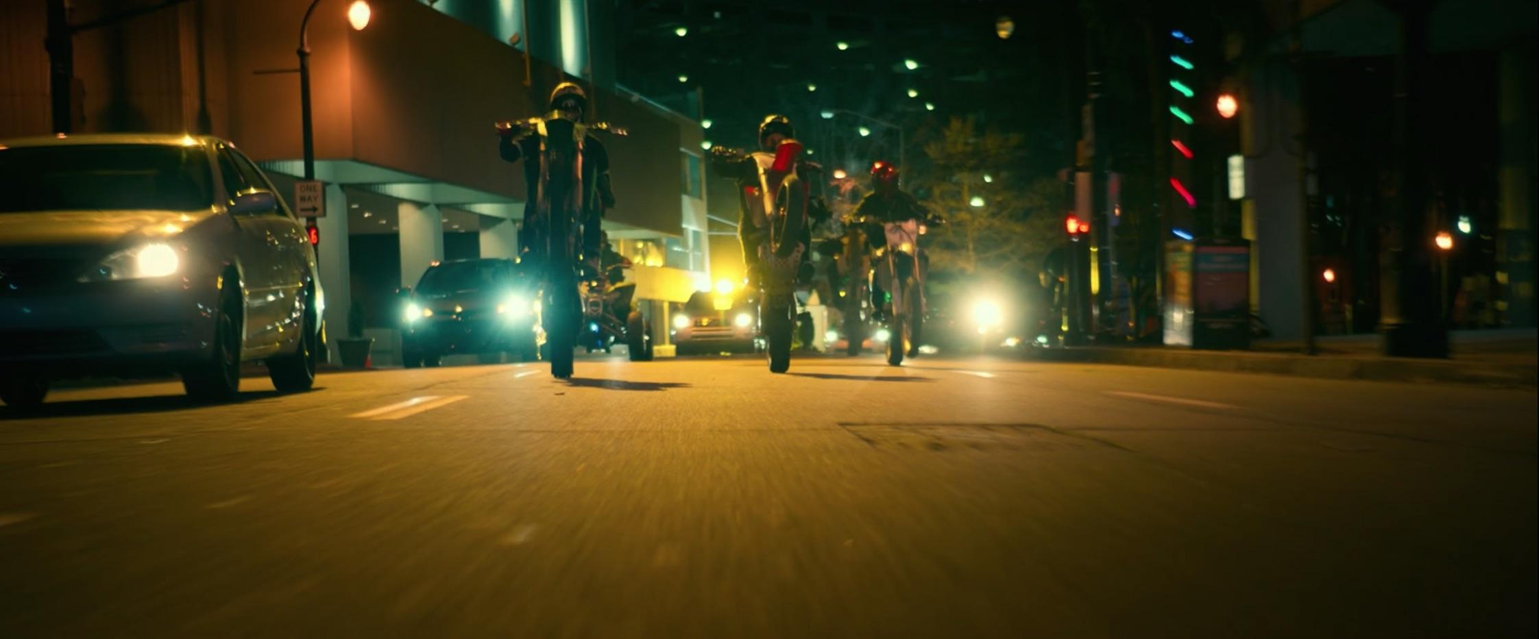 Bad Boys For Life motocross riders on street popping one wheel