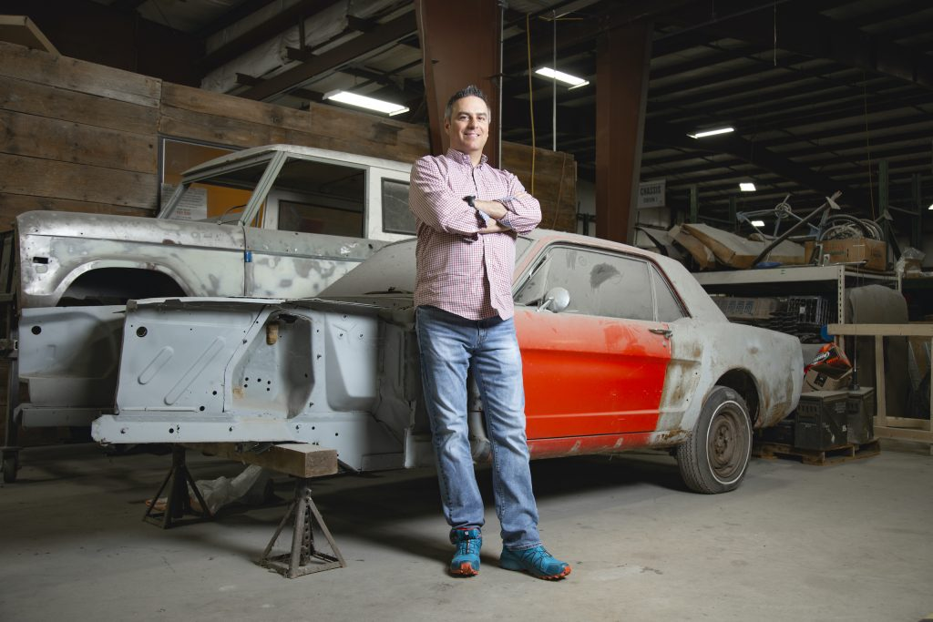 seth burgett beside ford bronco mustang restoration projects