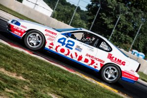 Cunningham Honda Racing dynamic track action side profile