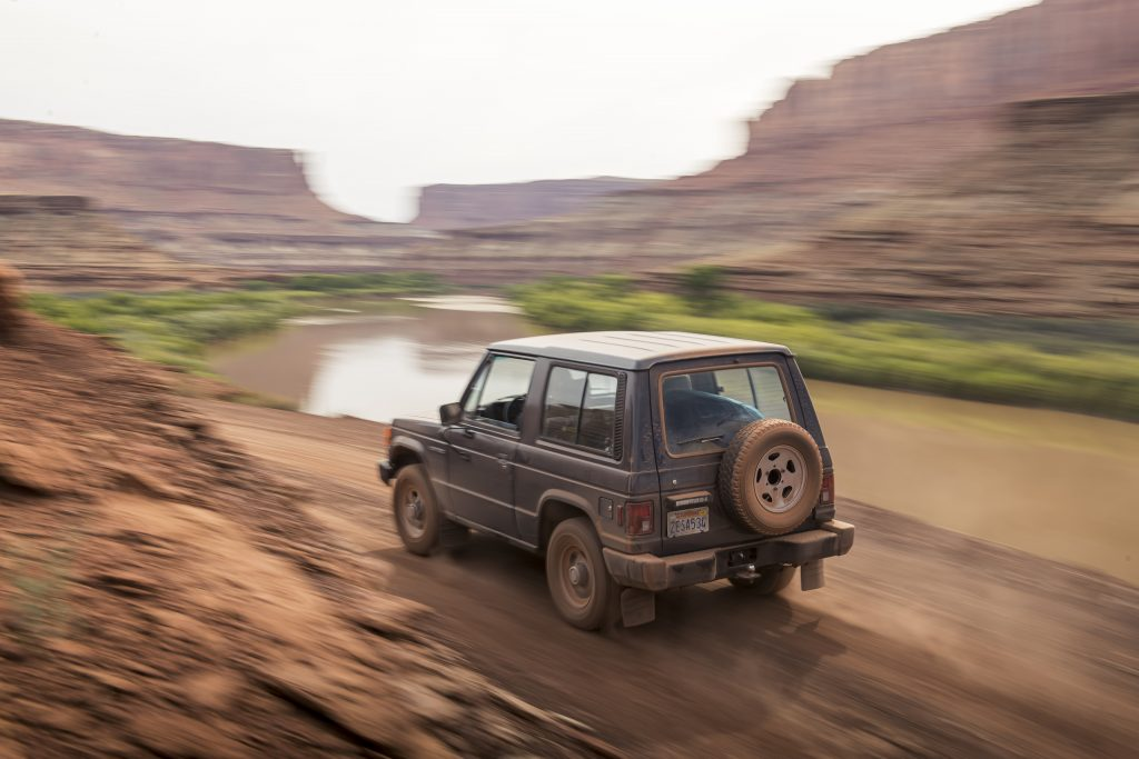 Mitsubishi Montero rear three-quarter dynamic trail action Canyonlands Moab Utah