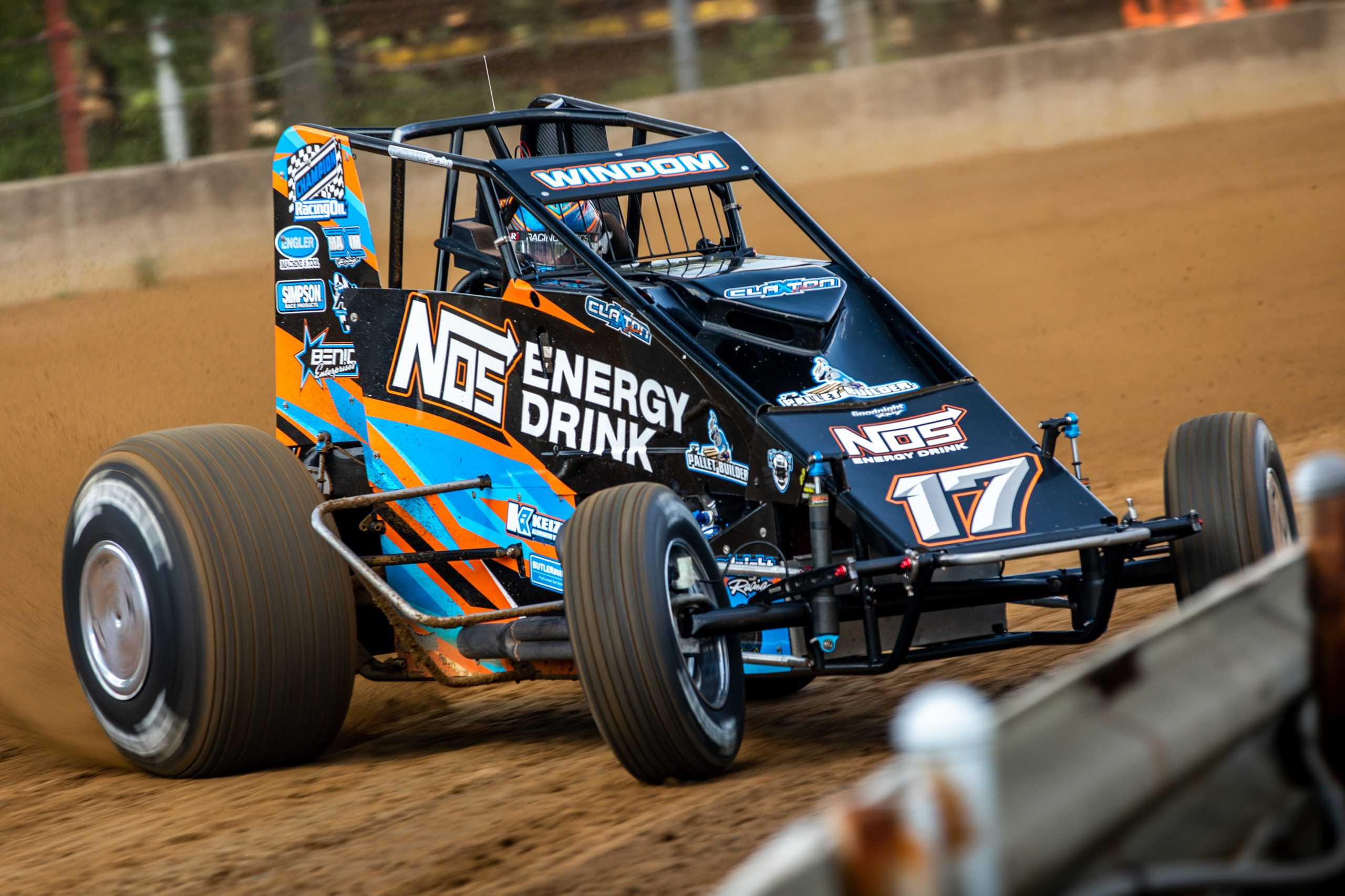 Silver Crown champ car on dirt track front three-quarter dynamic track action