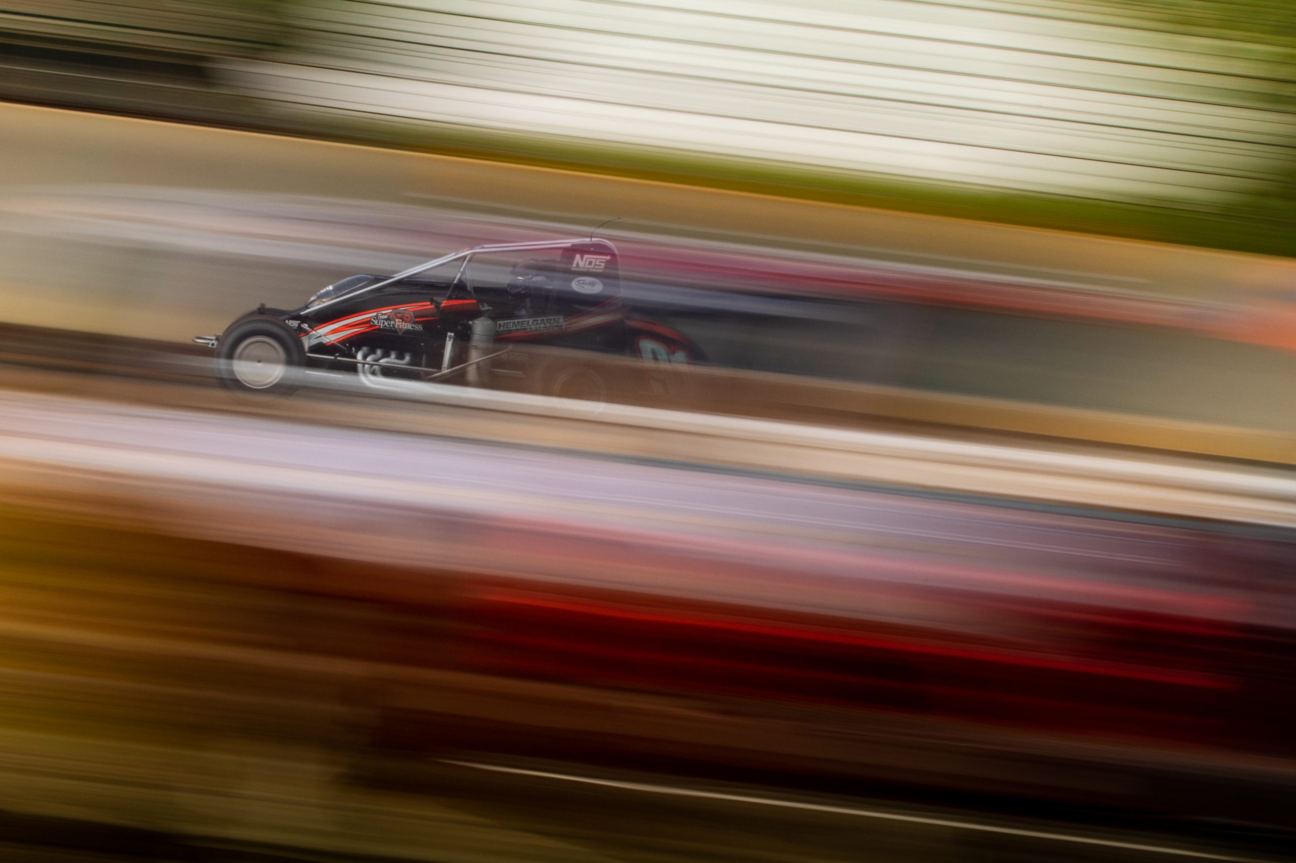 Silver Crown champ car on dirt track dynamic blur speed action