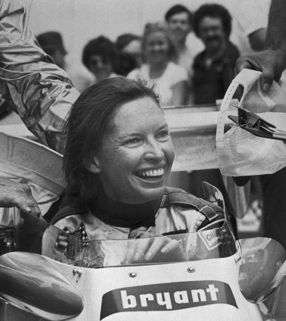 Janet Guthrie Grinning in Racecar