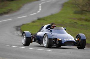 Rocket car front three-quarter dynamic road action