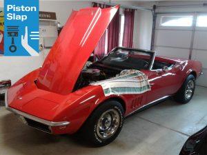 1968 red corvette garaged hood open