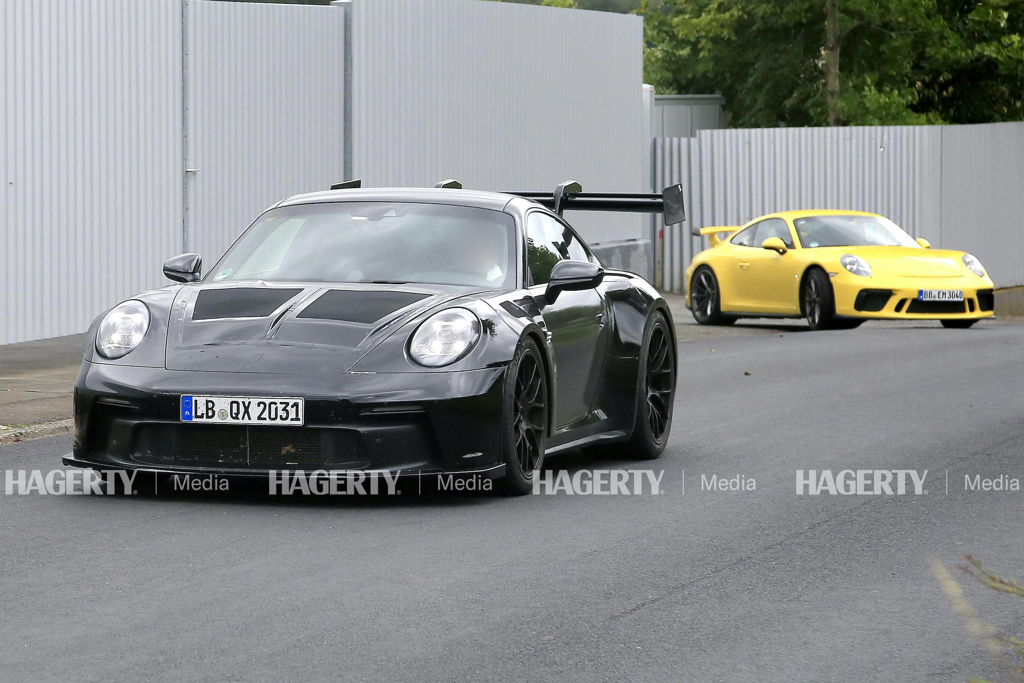 Porsche 911 GT3 RS front three-quarter test drive action trailing yellow porsche