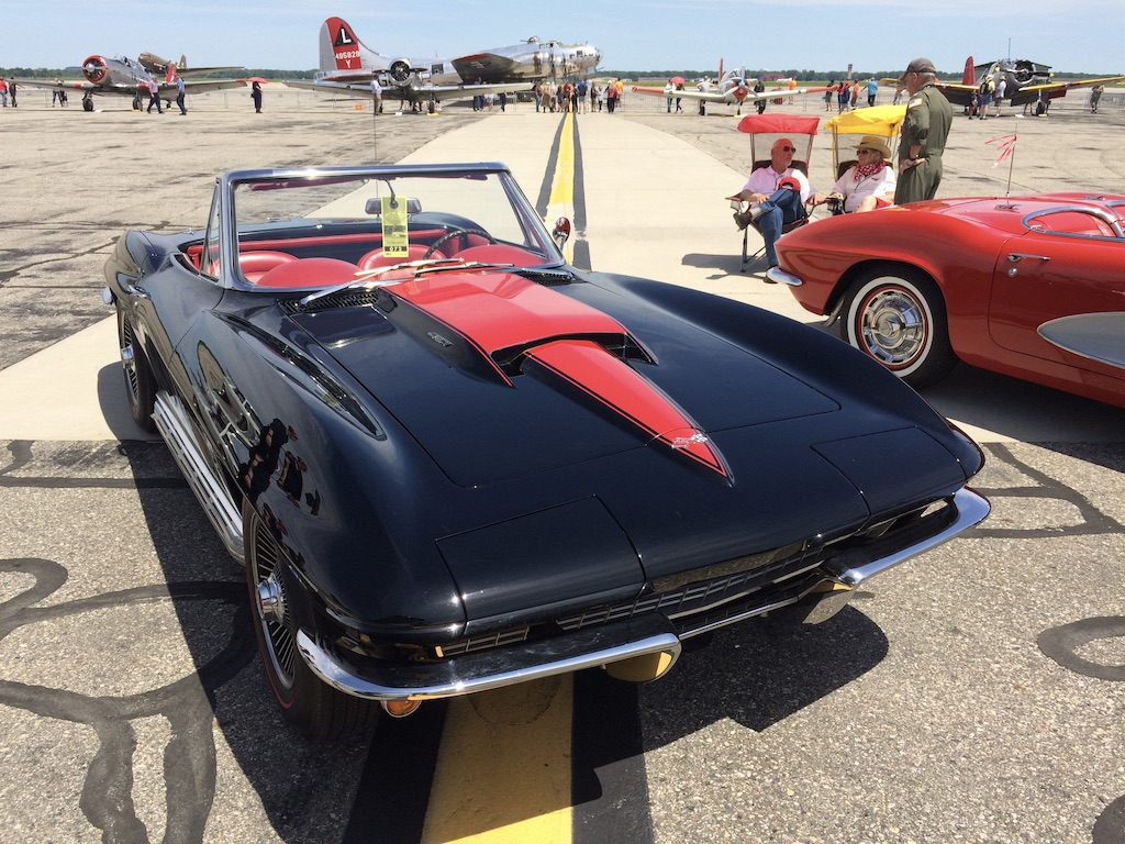 vintage black corvette convertible front three-quarter at airstrip