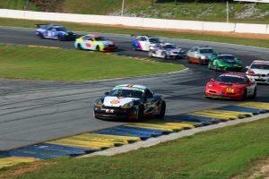 shift up motorsports on track action porsche leading pack