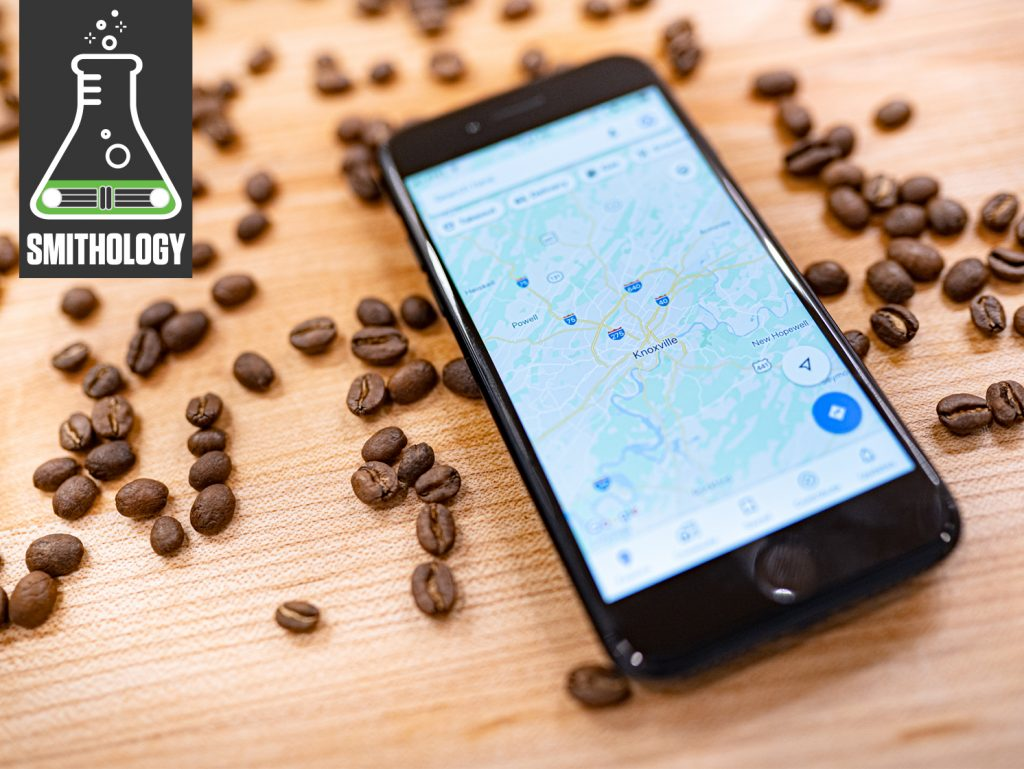 whole coffee beans wood table close up with phone map knoxville