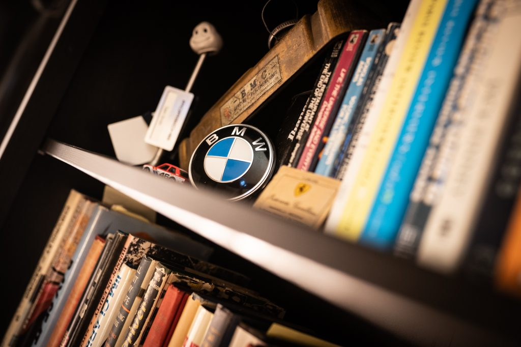 bmw logo badge on bookcase shelf