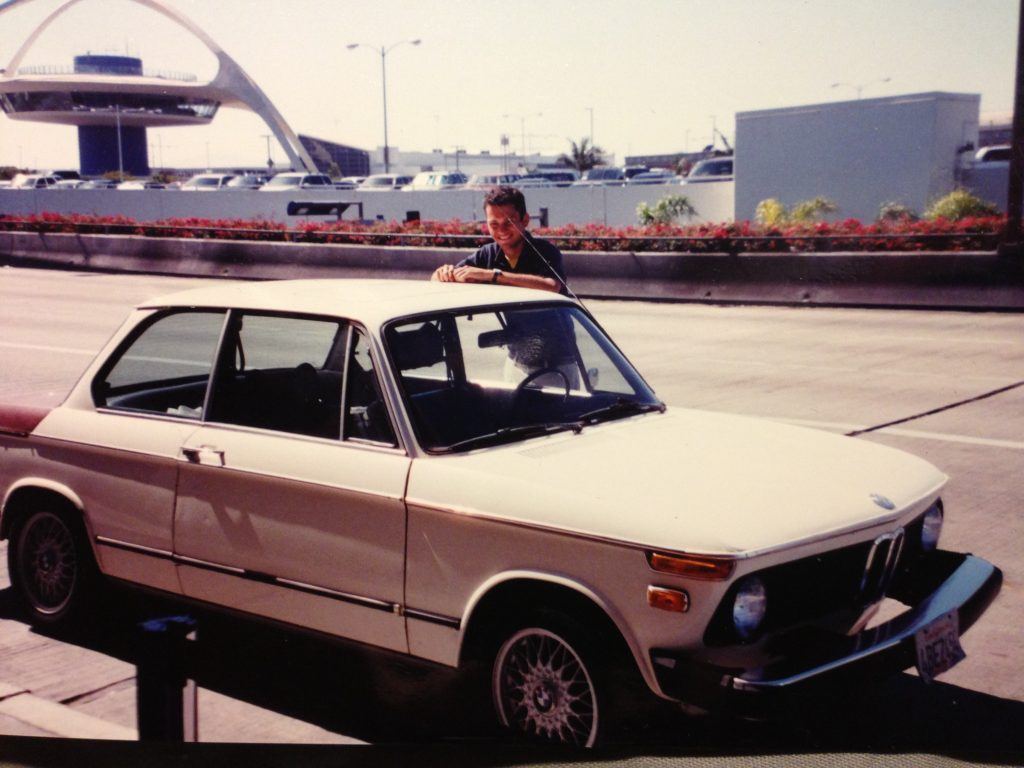 author sam smith with retro bmw 2002