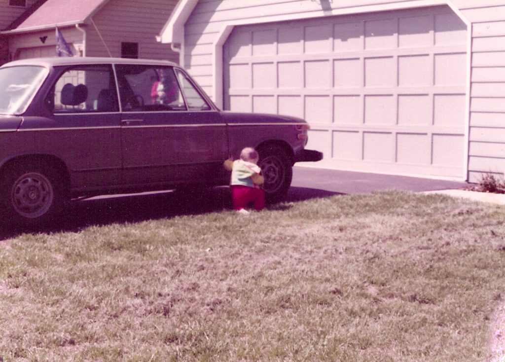 baby sam smith beside bmw 2002 in driveway
