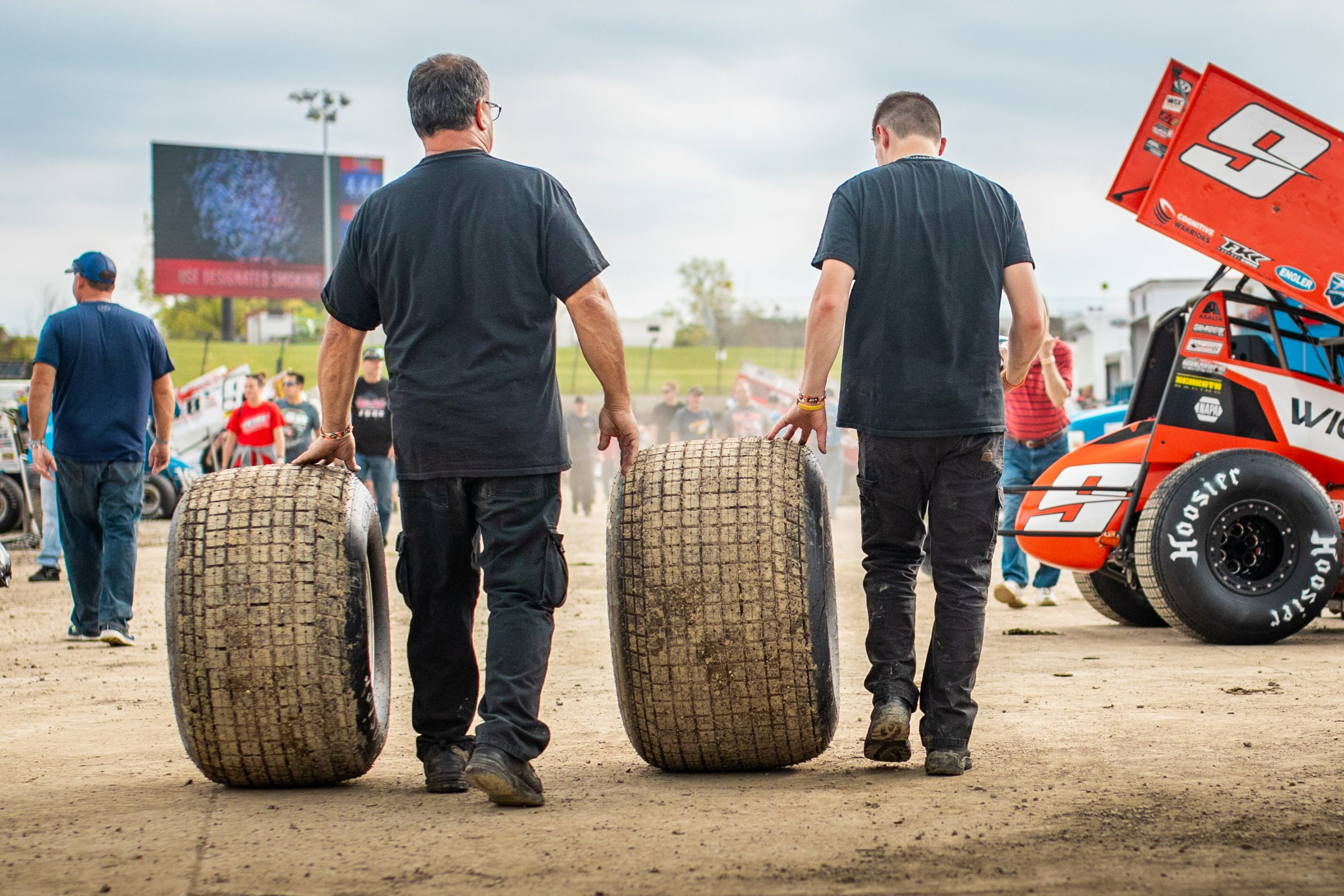 two men in black rolling thick hoosier tires