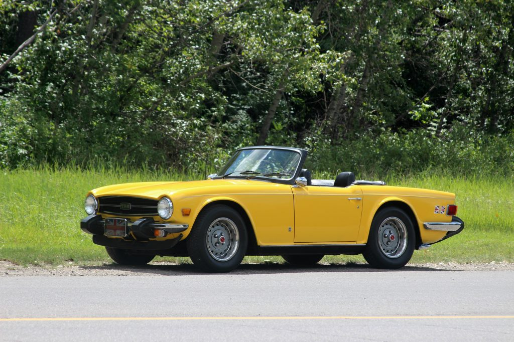 Triumph TR6 Yellow roadster front three-quarter