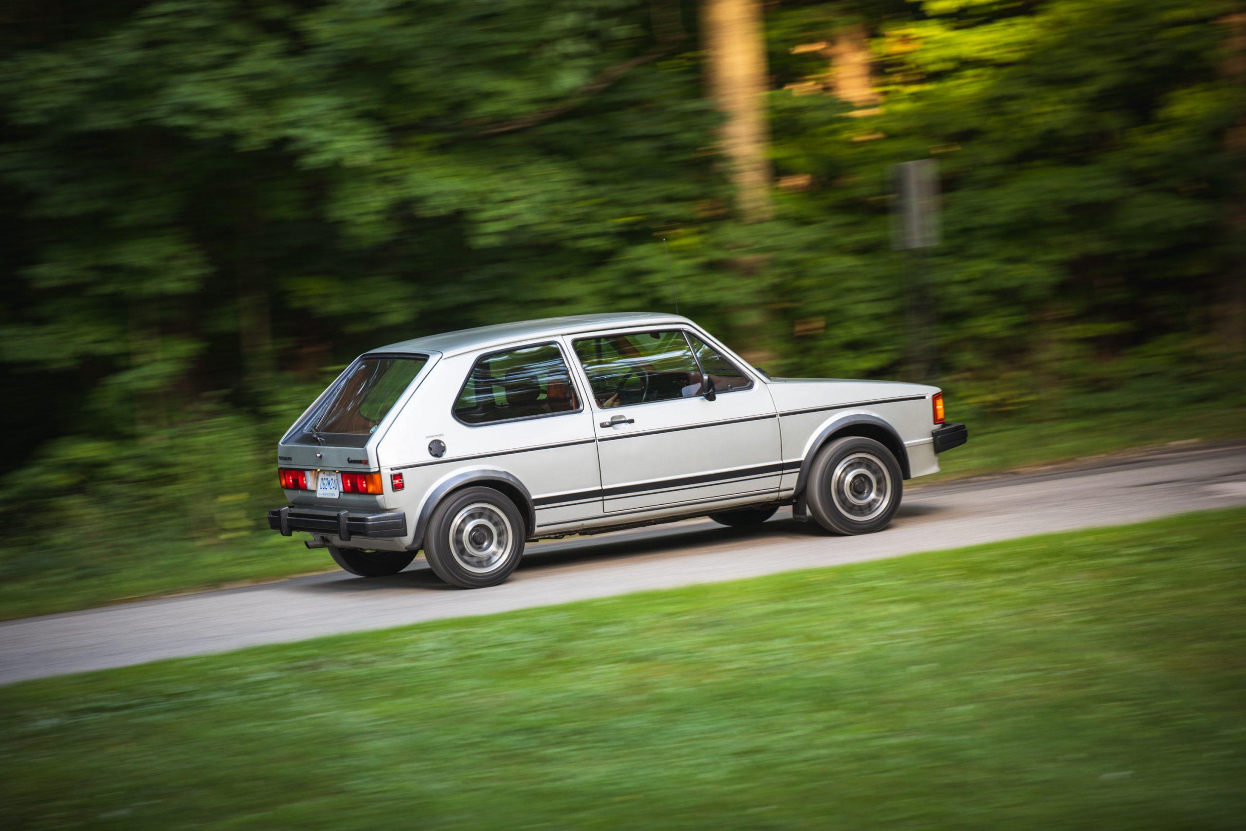 retro volkswagen rabbit gti hatchback rear three-quarter action