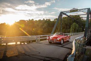 vintage volkswagen karmann ghia bridge crossing action