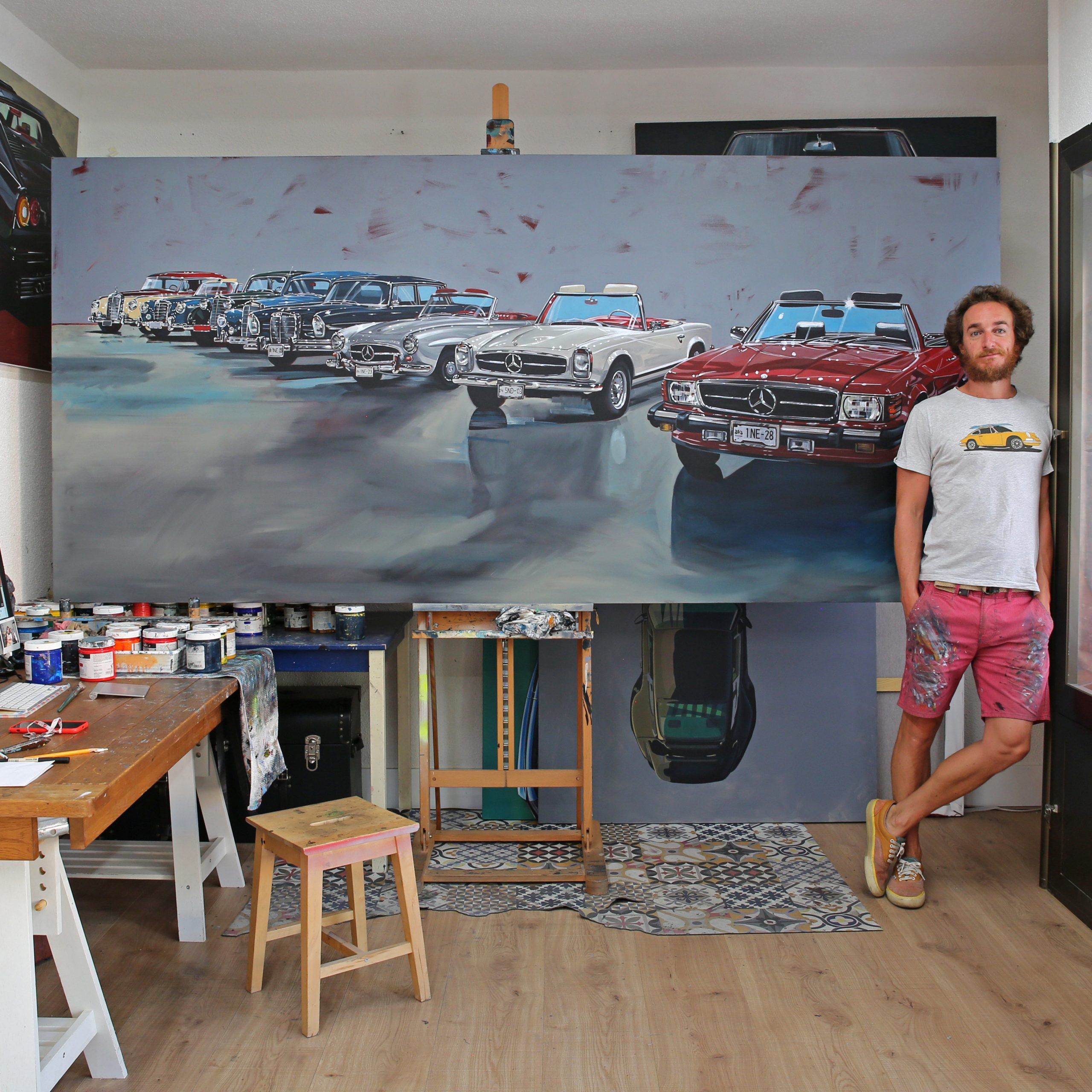 artist manu campa with classic mercedes-benz painting in studio