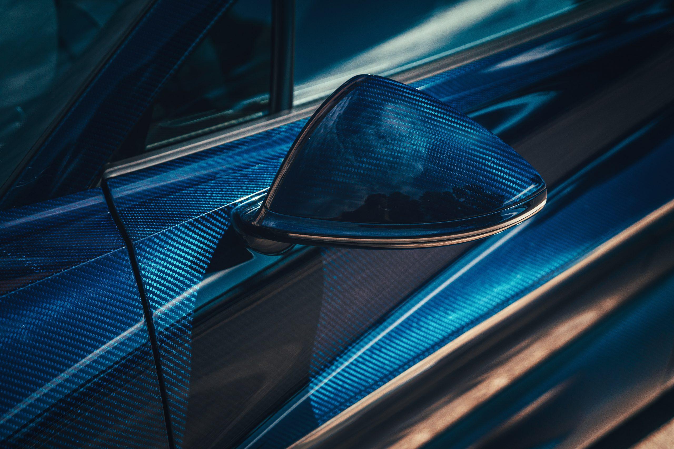 Bugatti Divo blue carbon fiber weave exposed
