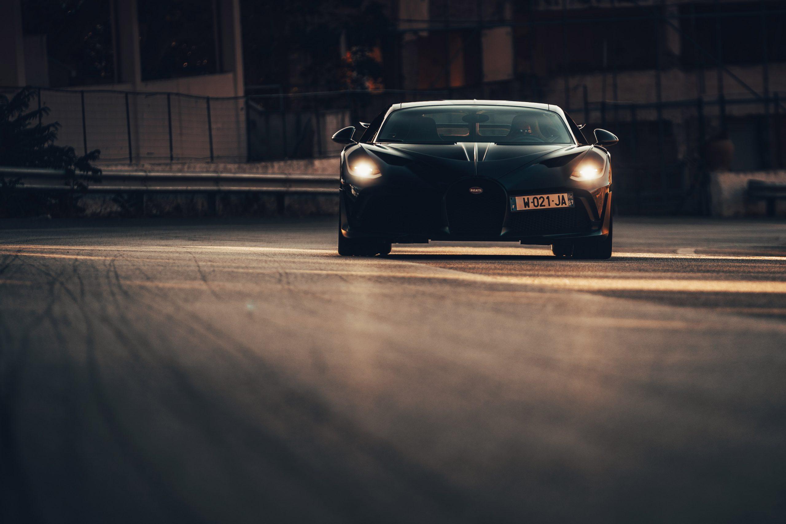 Bugatti Divo Targa Florio rolling head on evening headlights