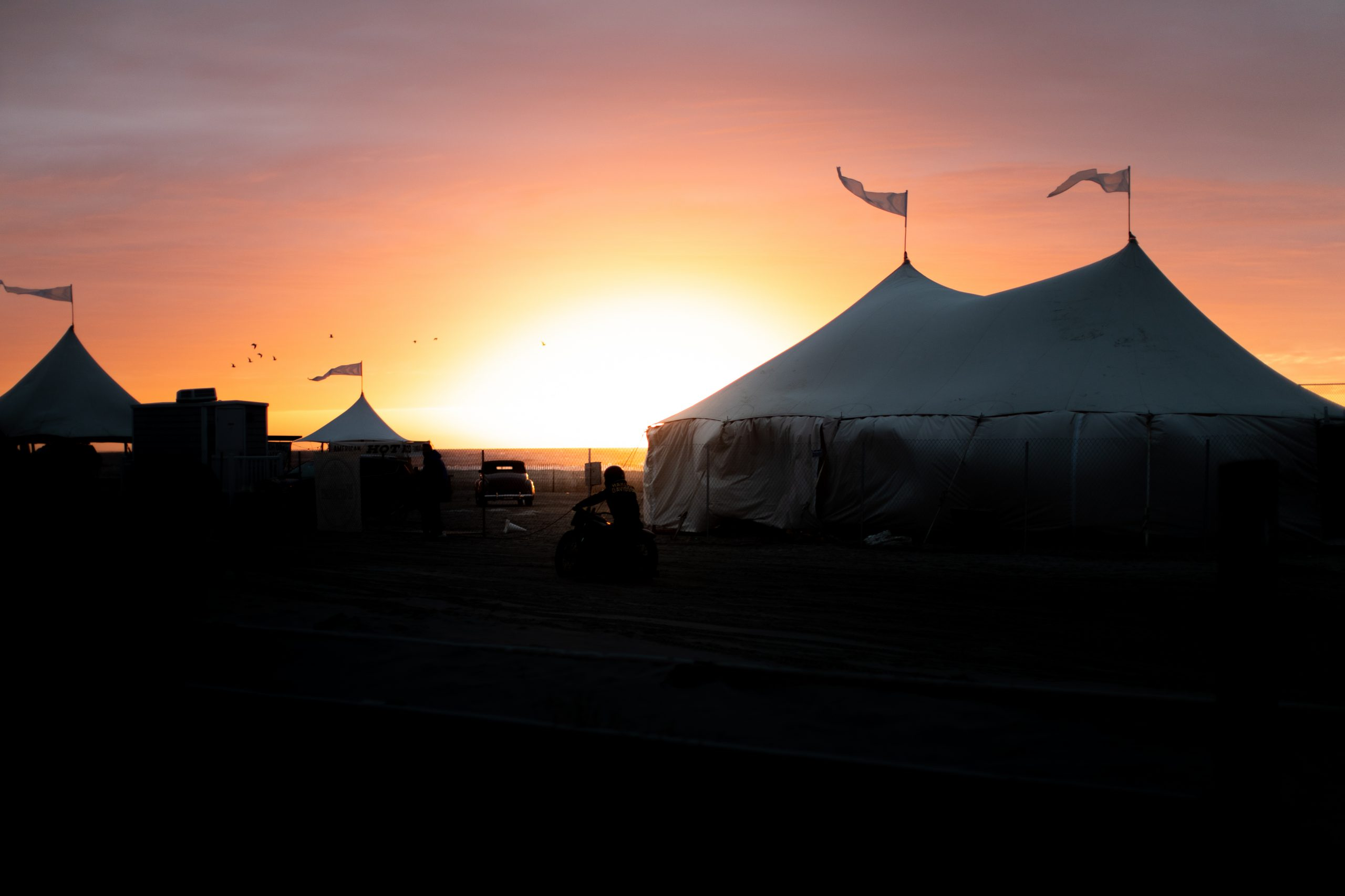motorbike beach drag race tent sunset