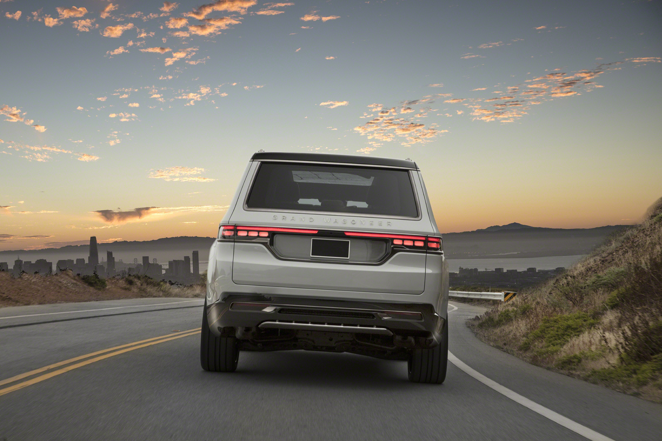 Grand Wagoneer Concept rear view on road