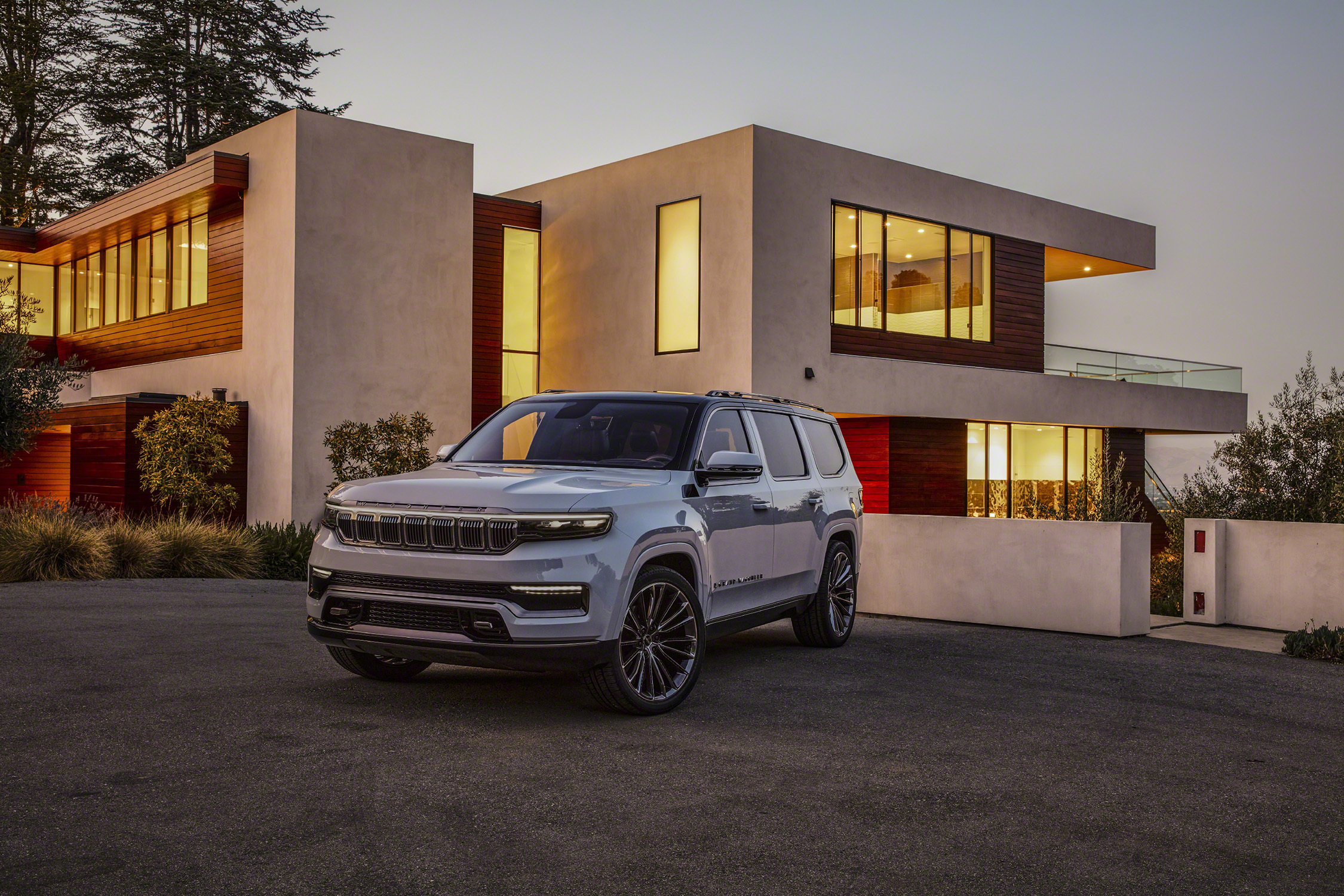 Grand Wagoneer Concept front three-quarter in front of desert house